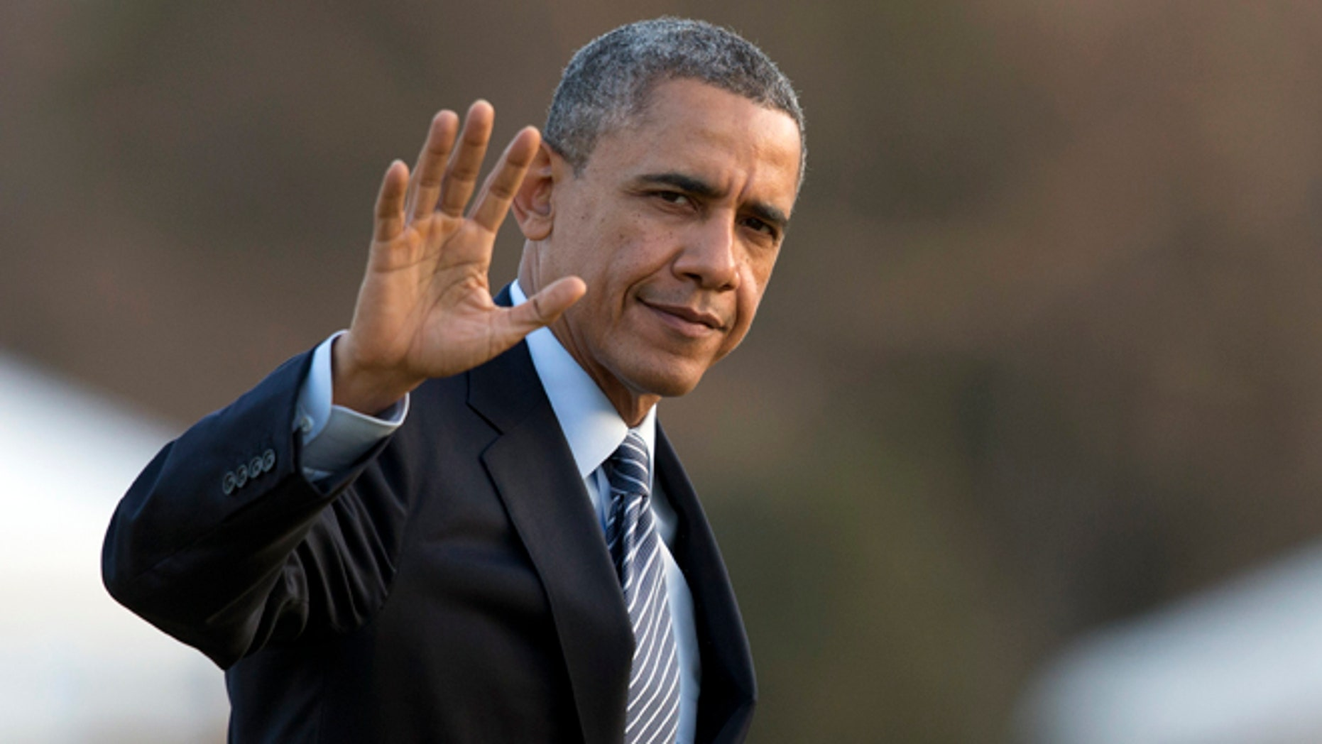 Feb. 7, 2014: President Obama waves as he arrives at the White House.