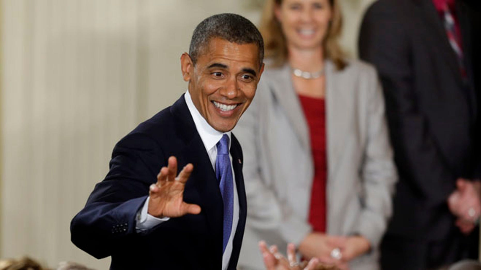 Sept. 18, 2012: President Obama waves to members of the audience during a ceremony honoring the WNBA Champion Minnesota Lynx at the White House.