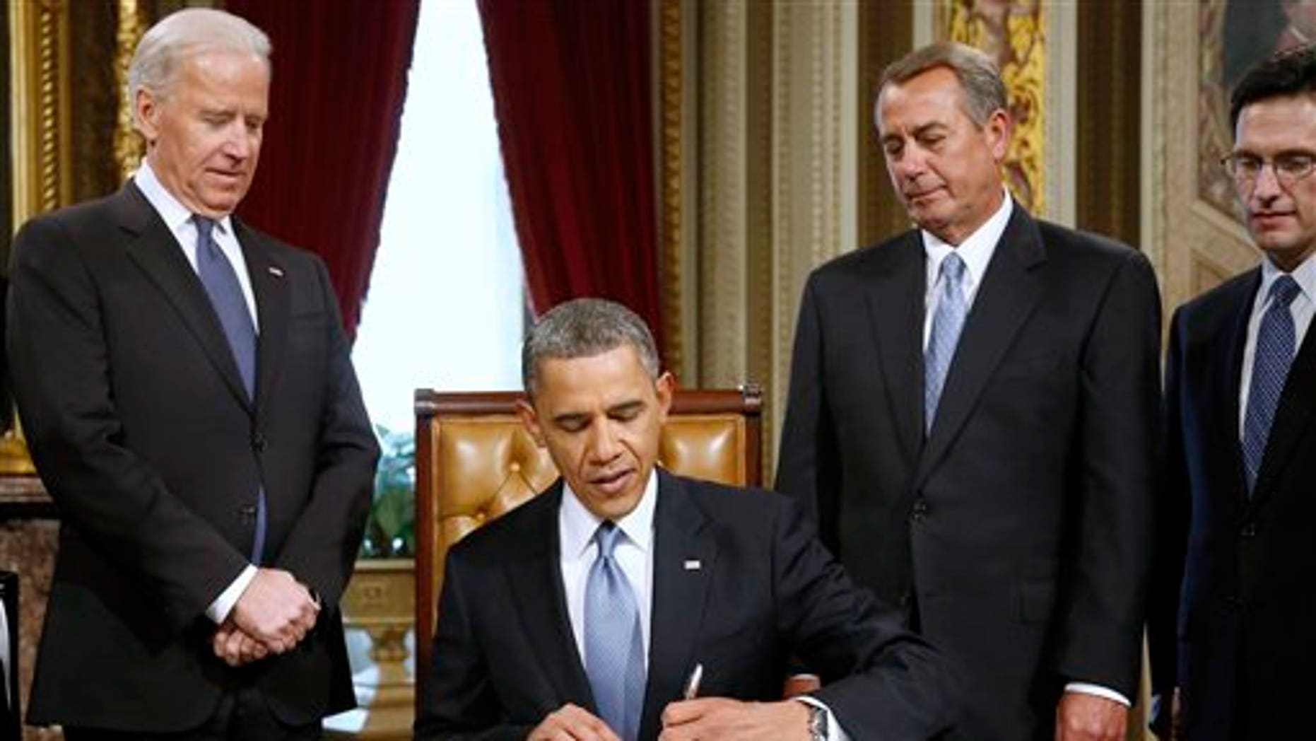 FILE: Jan. 21, 2013: President Obama signs a proclamation to commemorate the inauguration, on Capitol Hill, in Washington.