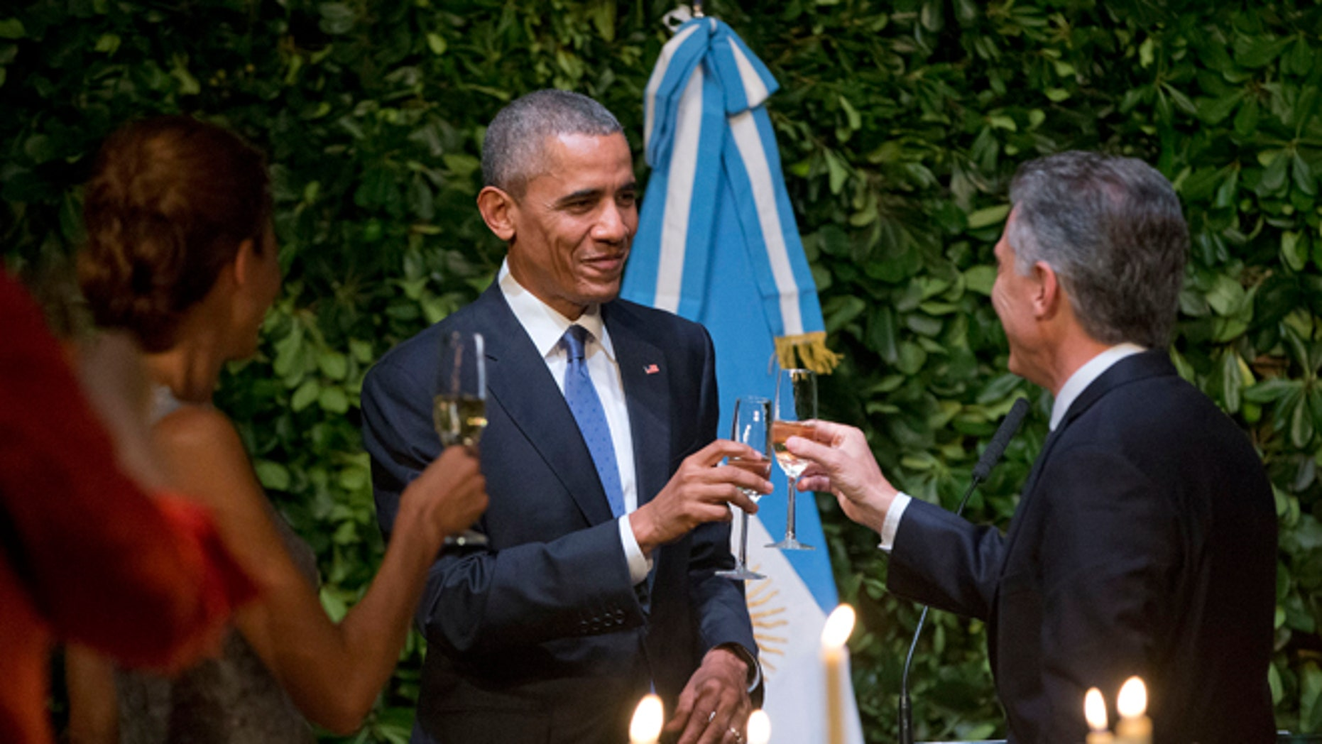 President Barack Obama and Argentinian President Mauricio Macri toast during the State Dinner at the Centro Cultural Kirchner, Wednesday, March 23, 2016, in Buenos Aires, Argentina. (AP Photo/Pablo Martinez Monsivais)