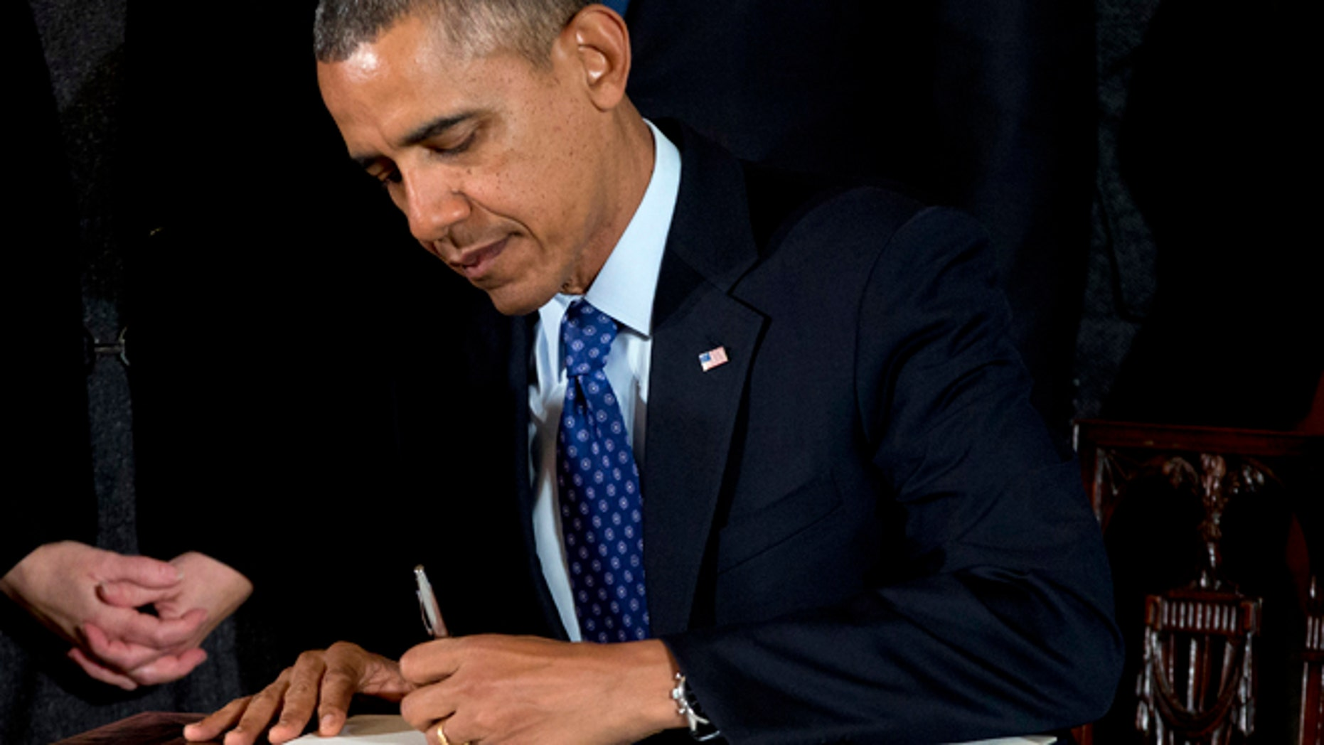 Jan. 22, 2014: President Barack Obama signs a memorandum creating a task force to respond to campus rapes during an event for the Council on Women and Girls in the East Room of the White House in Washington.