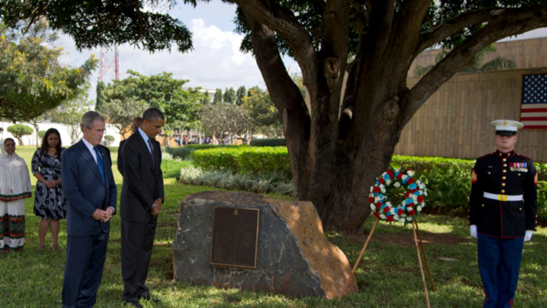July 2, 2013: President Barack Obama and former U.S. President George W. Bush pause for a moment of silence during a wreath laying ceremony to honor the victims of the U.S. Embassy bombing in Dar Es Salaam, Tanzania.