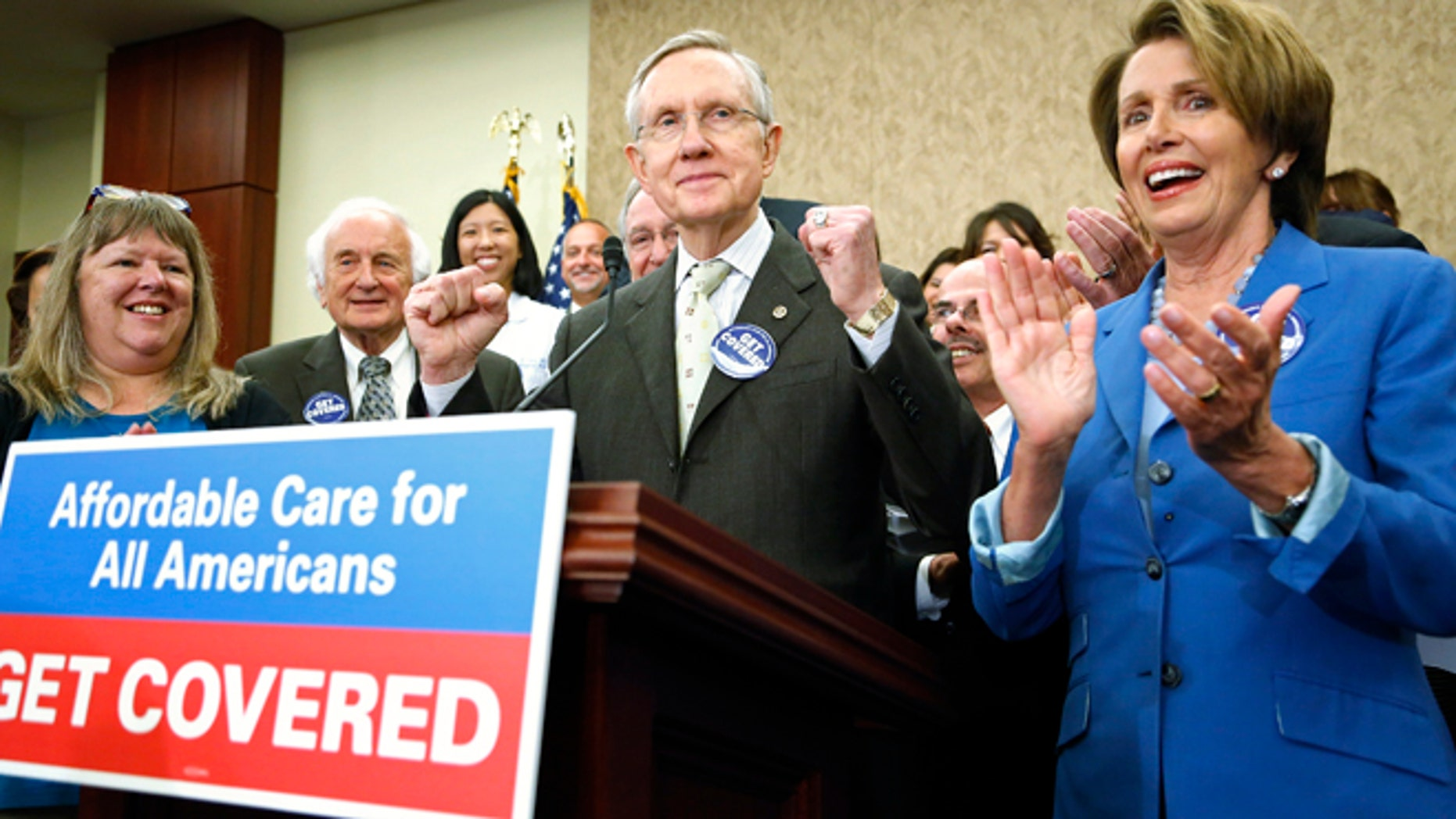 Oct. 1, 2013: U.S. Senate Democratic leader Harry Reid (C) and House Minority Leader Nancy Pelosi (R) lead a rally to celebrate the start of the Affordable Care Act (commonly known as Obamacare) at the U.S. Capitol in Washington.