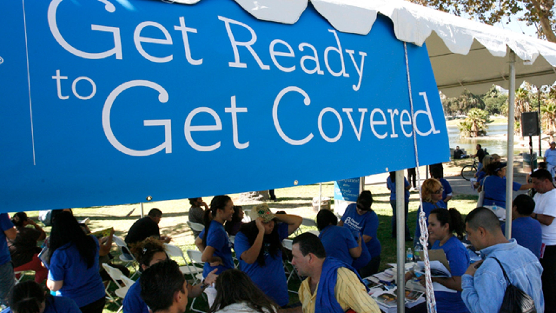 September 28, 2013: People gather for information during a Planned Parenthood Affordable Care Act outreach event.
