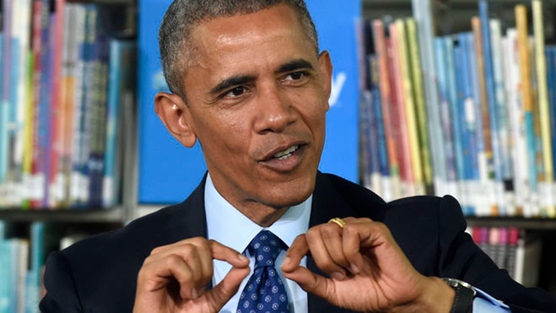 """Apr. 20, 2015: President Barack Obama speaks at Anacostia Library in Washington as he participates in a live """"virtual field trip"""" with middle school students to announce two initiatives to improve education through digital connectivity. (AP)"""