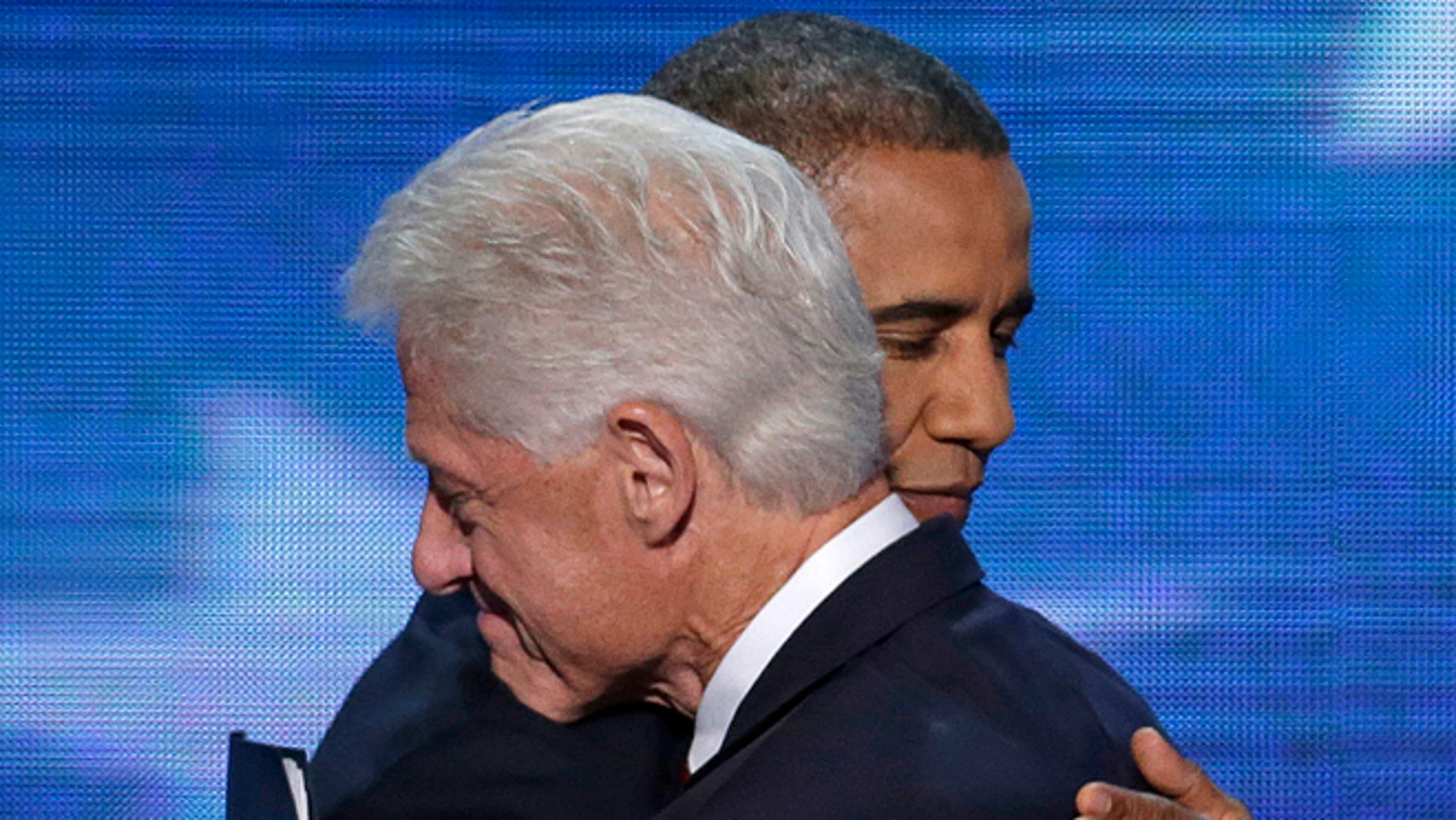 Sept. 5, 2012: Former President Bill Clinton hugs President Barack Obama after President Obama walked on stage after Clinton's speech the Democratic National Convention in Charlotte, N.C.
