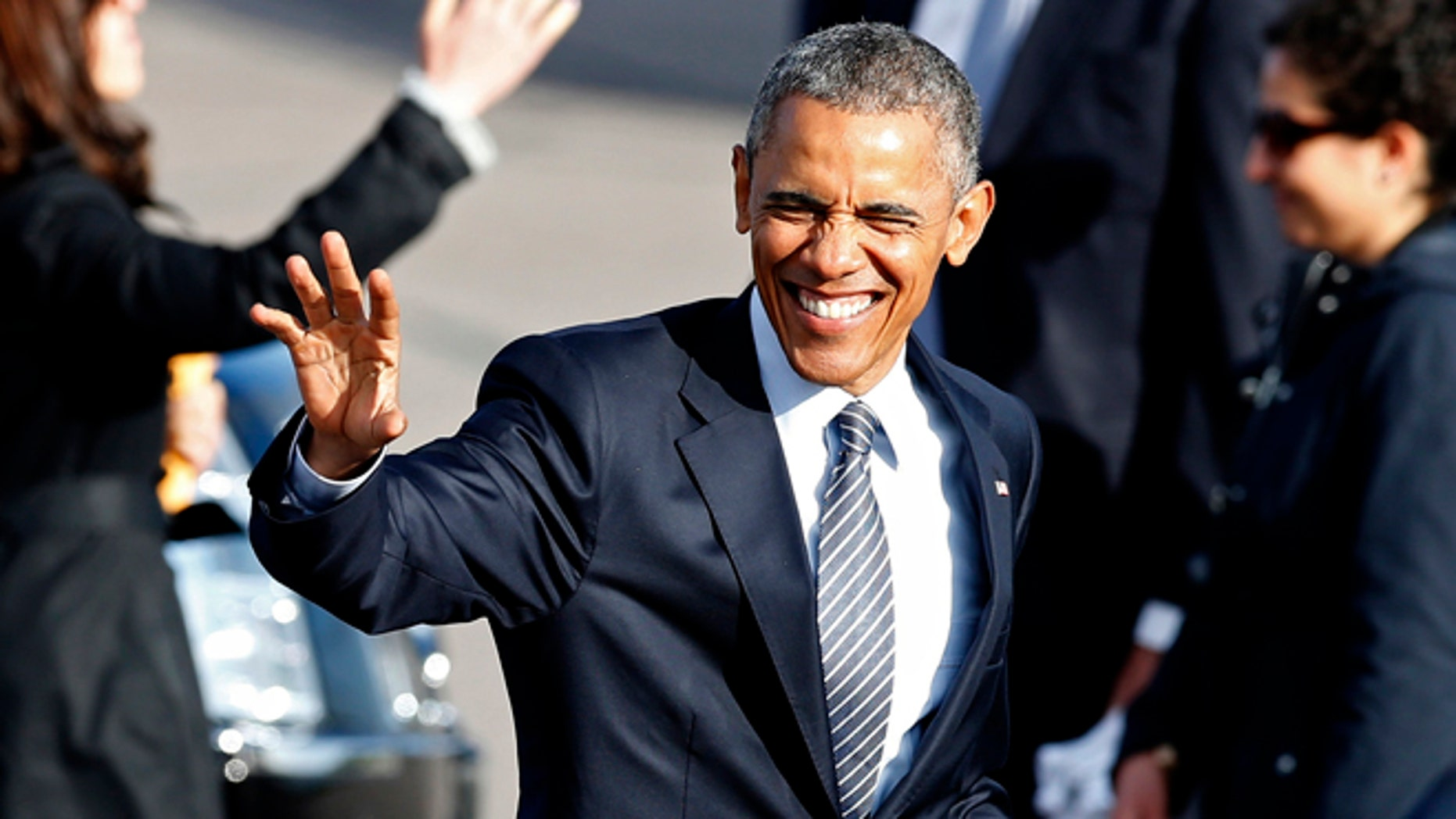 May 8, 2015: President Obama waves to supporters before leaving the Watertown Regional Airport in Watertown, S.D., where he gave a commencement address at a community college. (AP)