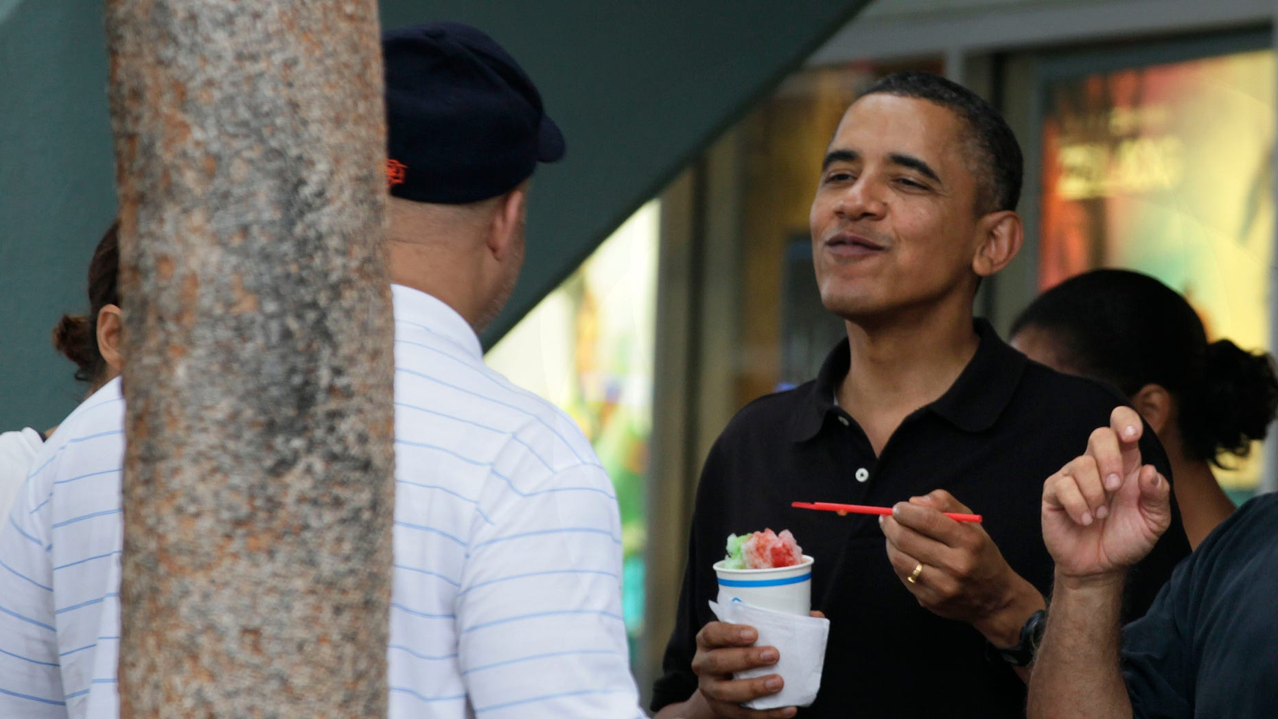 Obama shown here Dec. 27, eats Shave Ice with family and friends at Island Snow at Kailua Beach Center while on vacation with the first family in Kailua, Hawaii. Barack Obama will push back the release of his budget proposal for fiscal year 2012 by about a week, a delay administration officials blame in part on a hold placed on Obama's nominee for budget director.