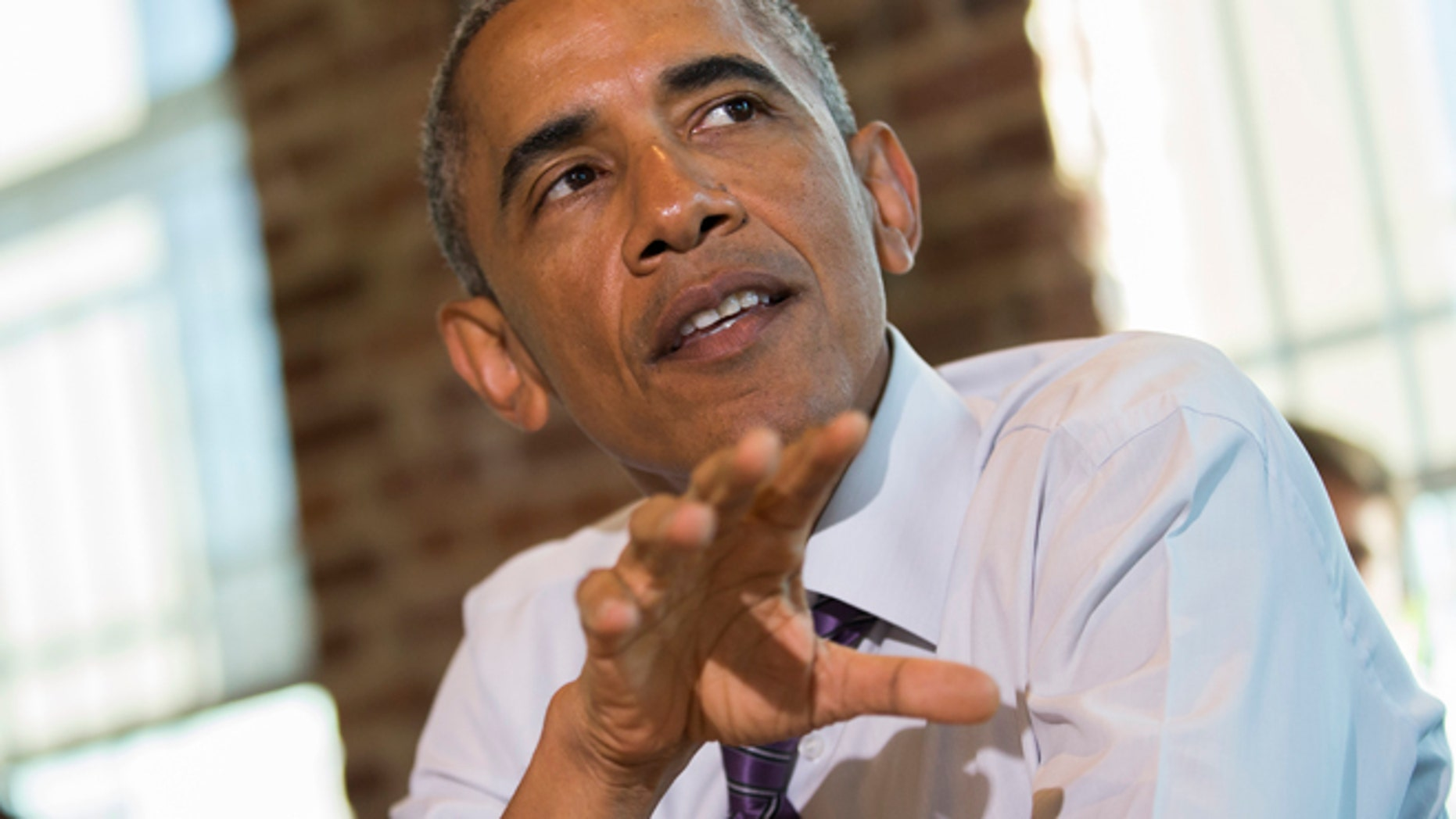 Jan. 15, 2015: President Barack Obama speaks about proposed legislation to offer paid sick leave for working Americans during a stopping at Charmington's Cafe in Baltimore,