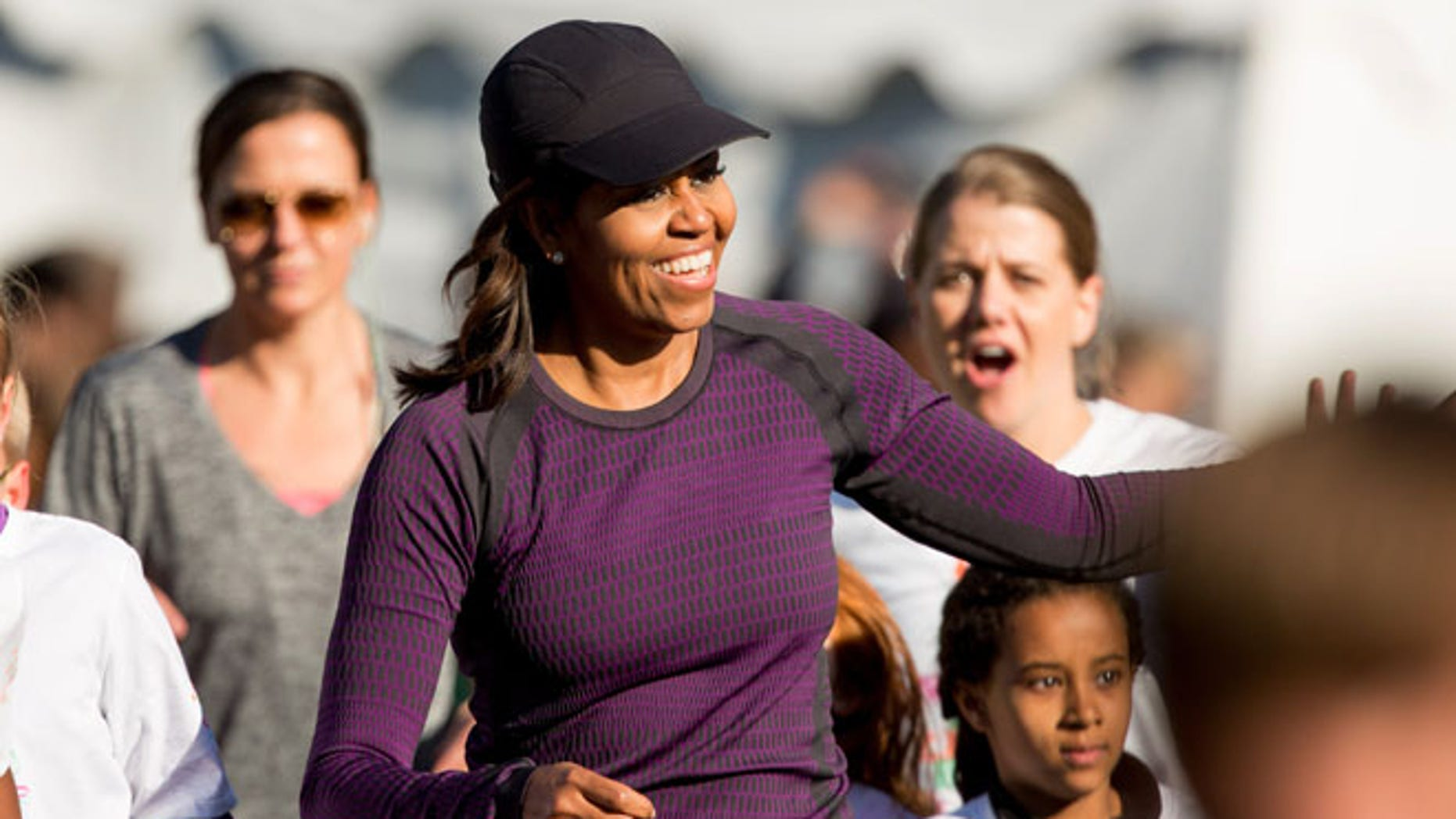 """Mar. 26, 2016: First lady Michelle Obama gets greeted from the audience as she participates in her first ever """"fun run"""" with children on the South Lawn of the the White House in Washington as part of her focus of healthy lifestyles for children."""