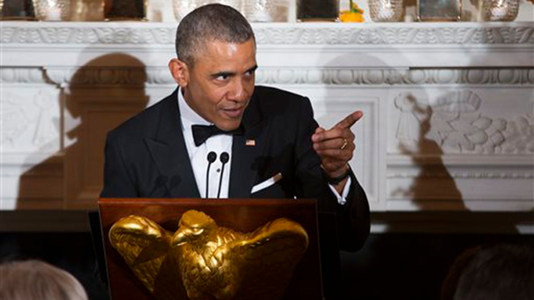 President Barack Obama delivers remarks during a National Governors Association dinner in the State Dining room of the White House, on Sunday, Feb. 21, 2016, in Washington. (AP Photo/Evan Vucci)