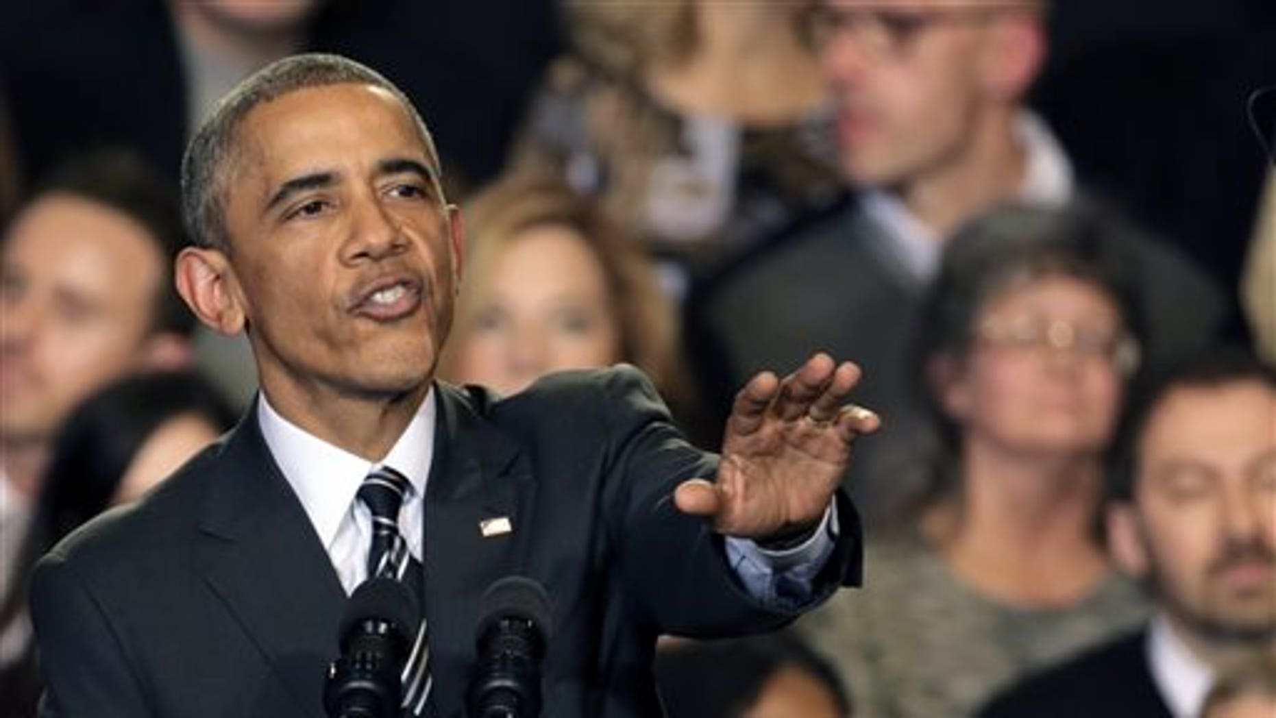 Nov. 25, 2014: President Barack Obama tries to quiet one of three hecklers as he addresses the crowd after meeting with community leaders about the executive actions he is taking to fix the immigration system.