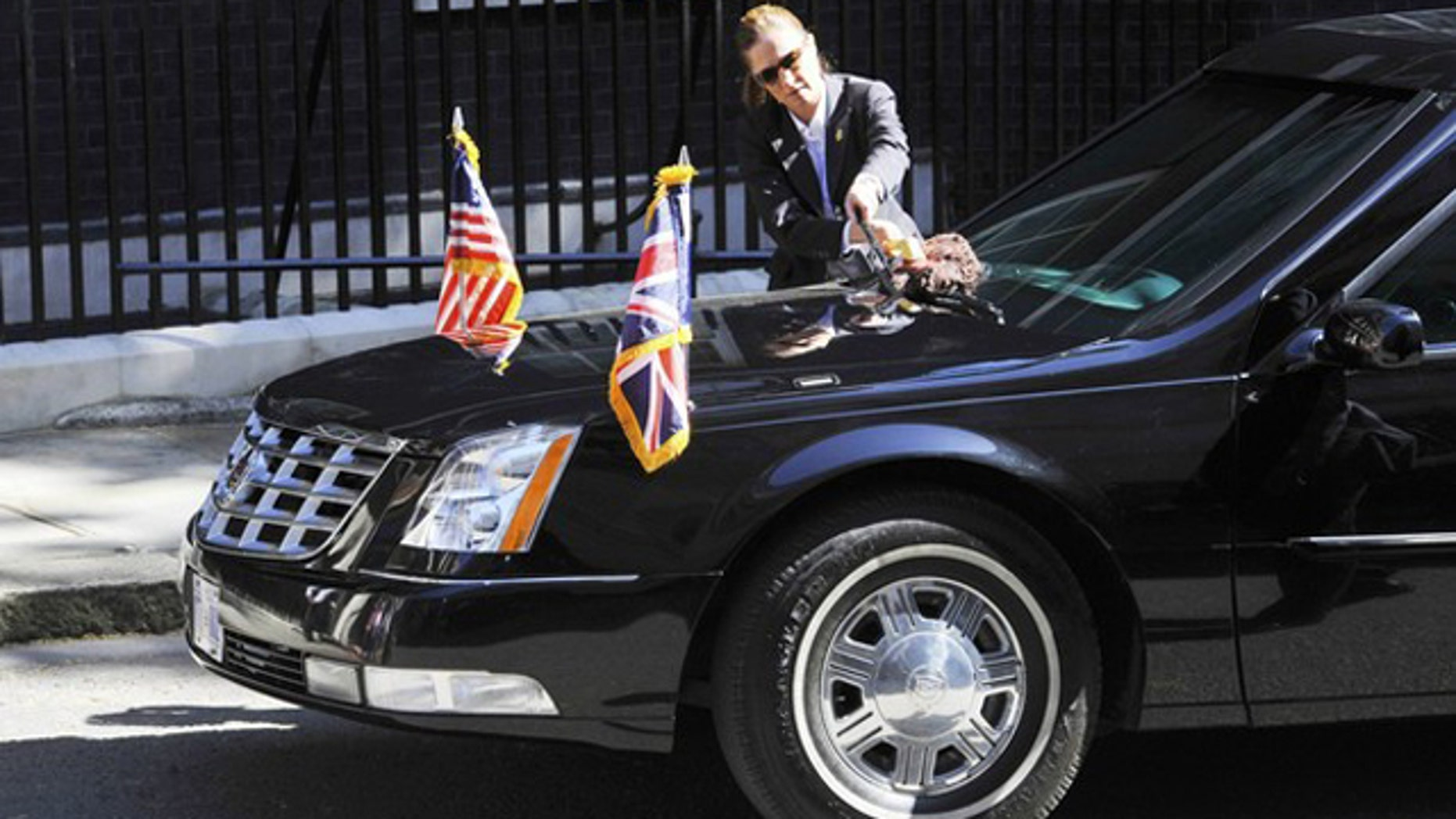 The armoured limousine of U.S. President Barack Obama is cleaned outside the 10 Downing Street residence of Britain's Prime Minister David Cameron in London May 25, 2011.