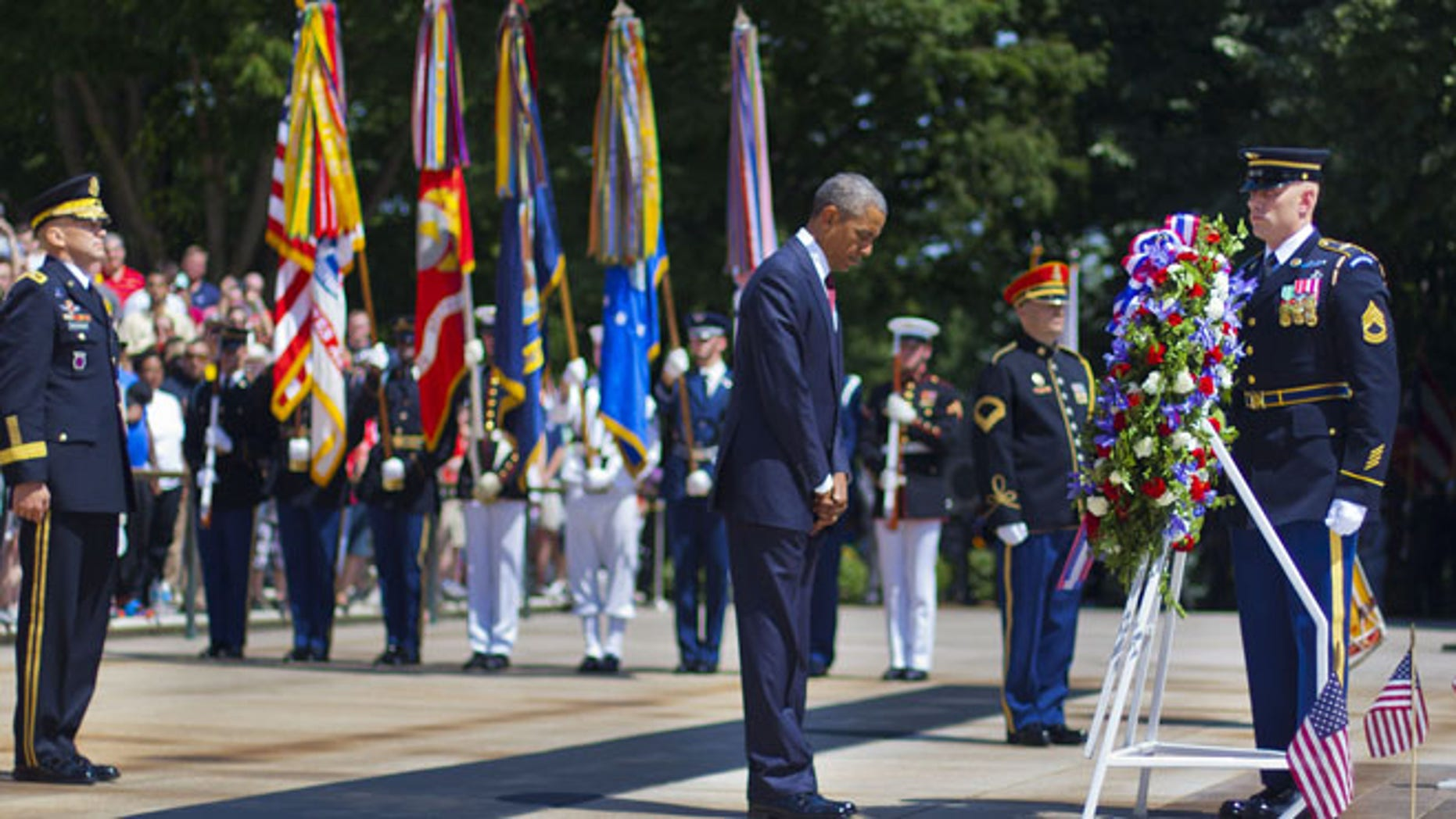 May 25, 2015: President Obama, center accompanied by Maj. Gen. Jeffrey S. Buchanan, left, Commander of the U.S. Army Military District of Washington, and Sgt. 1st Class John C. Wirth, right.