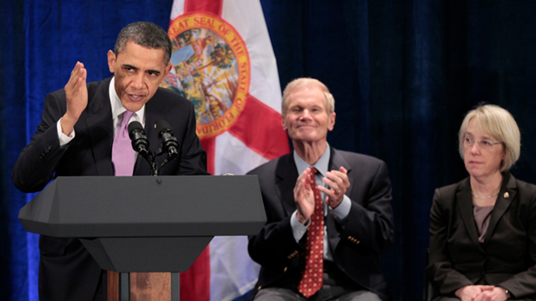 March 4, 2011: President Barack Obama, left, with Sen. Bill Nelson, D-Fla., center, and Sen. Patty Murray, D-Wash., right, during a Democratic fundraiser at Fontainebleau Resort.