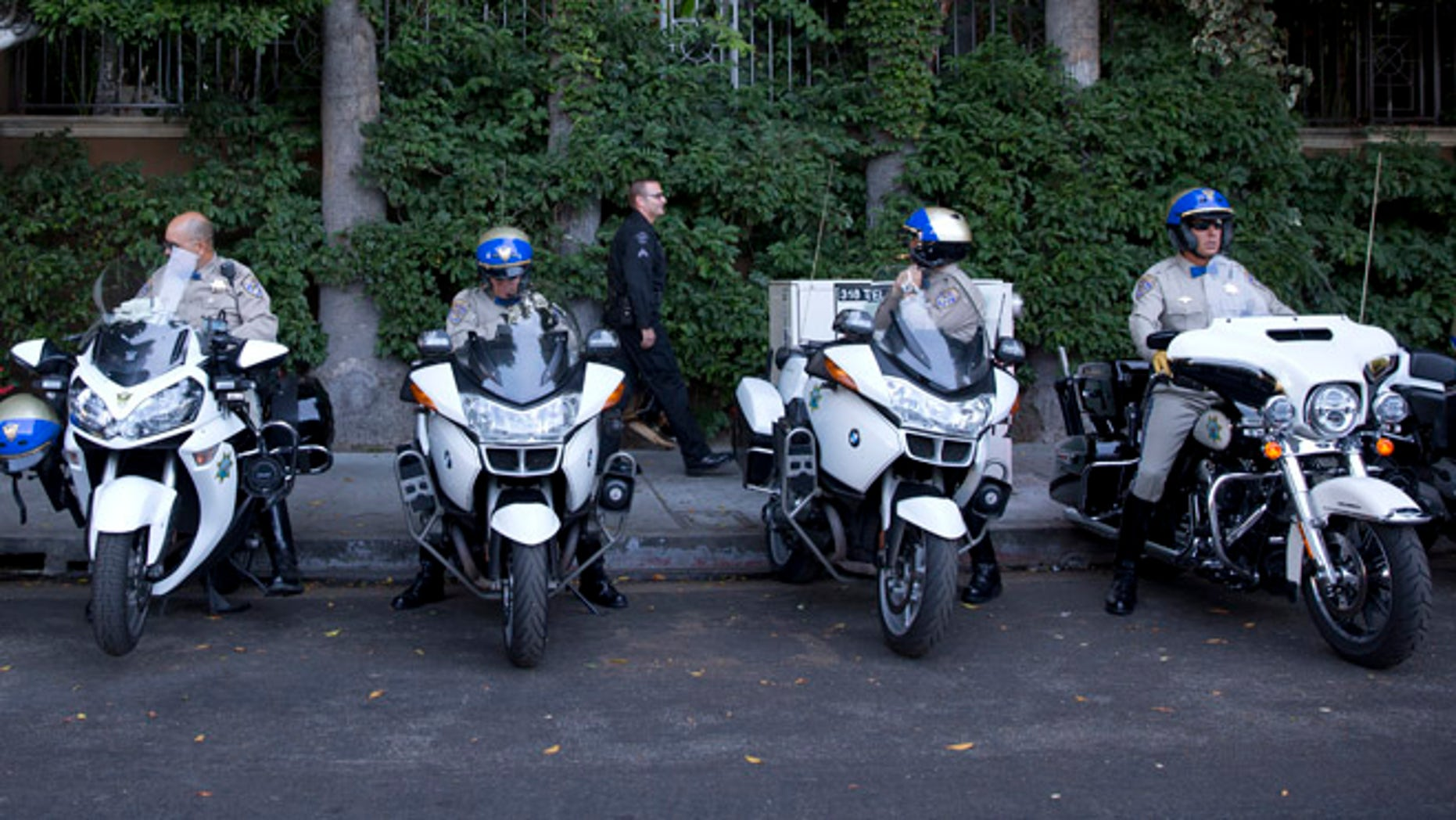 July 23, 2014: California Highway Patrol officers prepare to accompany the motorcade of President Barack Obama to a fundraising event in Los Angeles, the final city in his three-day West Coast trip to Seattle, San Francisco and Los Angeles. (AP)