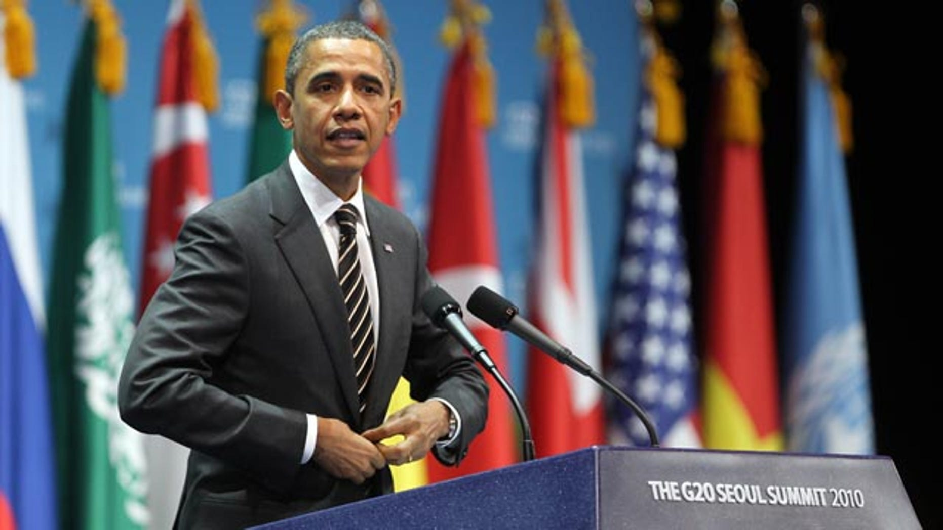Nov. 12: Obama gestures during a closing press conference at the G20 Summit in Seoul, South Korea. Obama said the decision by the Federal Reserve to pump $600 billion into the U.S. economy was designed to give a boost to a slow recovery and address fears of deflation.