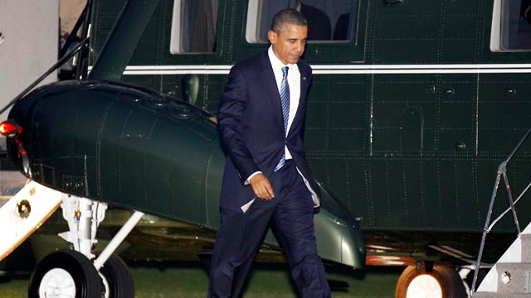 Nov. 23: President Barack Obama walks across the South Lawn of the White House in Washington.