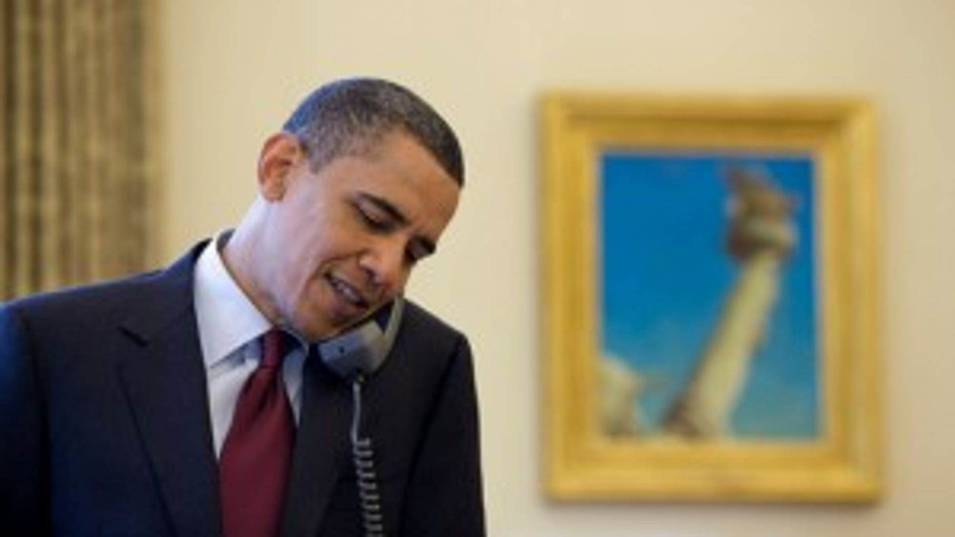 President Barack Obama talks on the phone with Associate Justice John Paul Stevens, in the Oval Office, after announcing that he would be retiring from the Supreme Court, April 9, 2010. (Official White House Photo by Pete Souza)