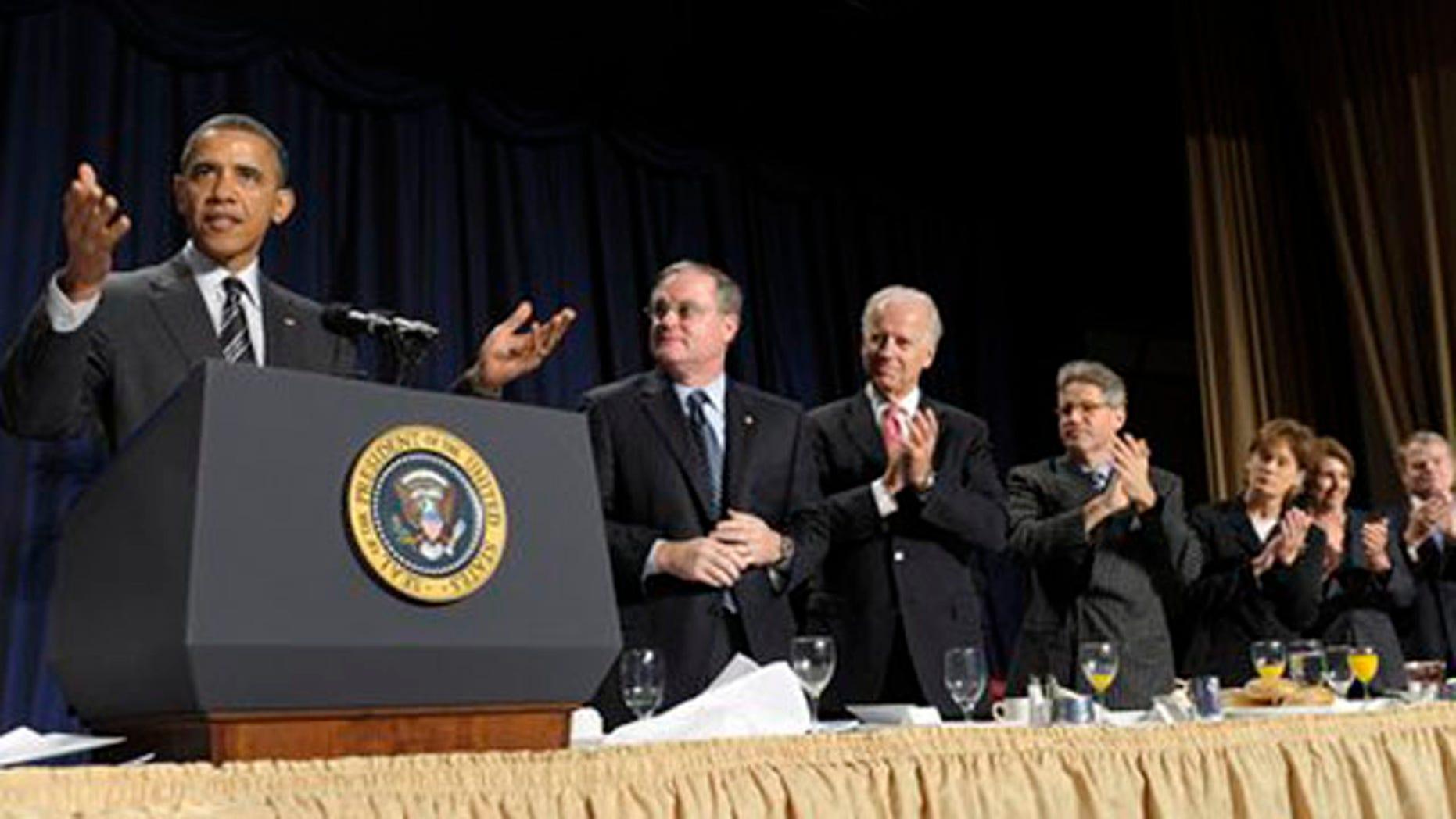 Feb. 2, 2012: President Barack Obama gestures while speaking at the National Prayer Breakfast in Washington.