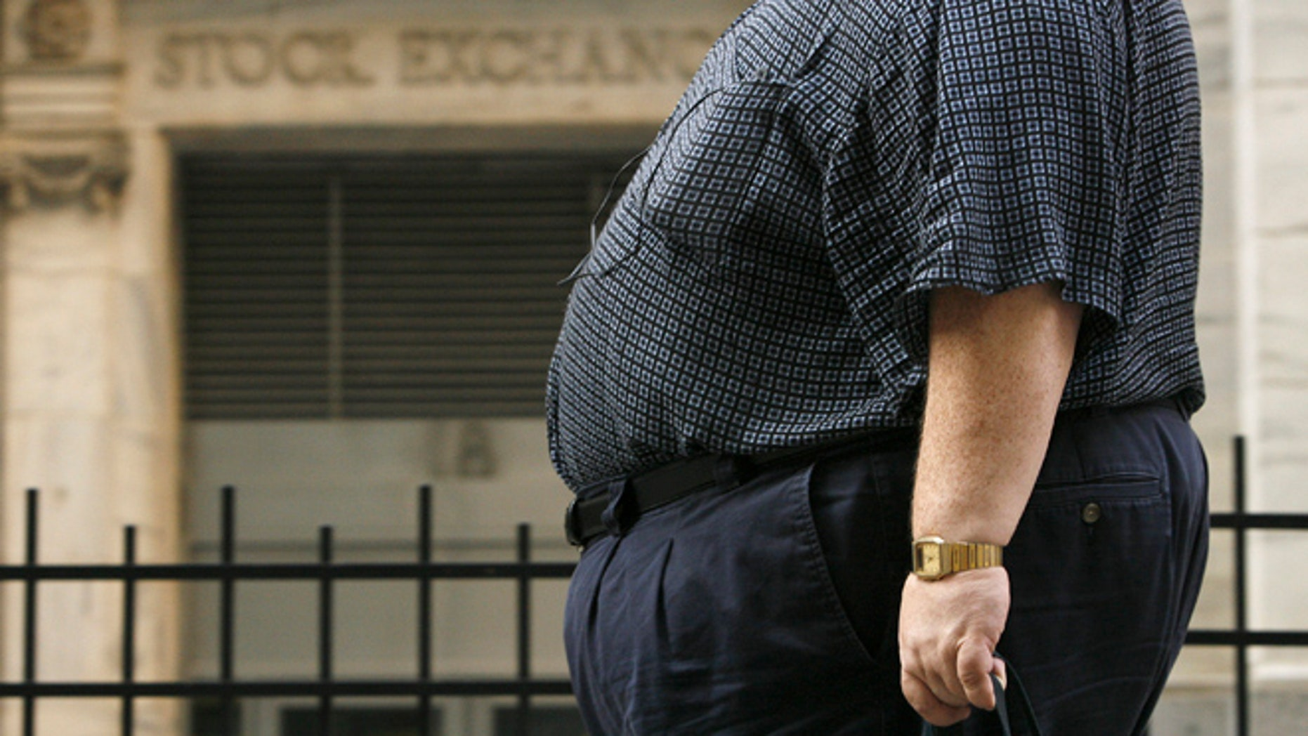 Aug. 17, 2009: A man walks past the New York Stock Exchange after trading hours in New York.