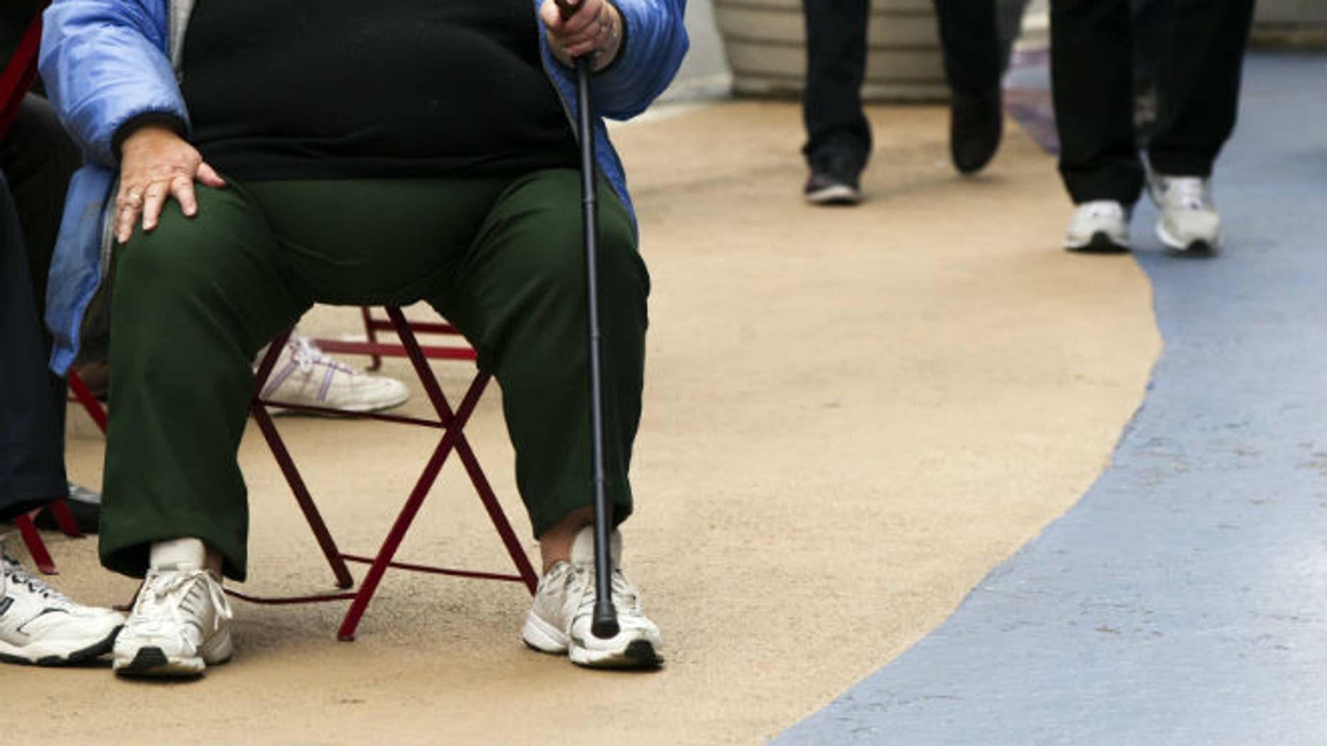 An overweight woman sits on a chair in Times Square in New York. (REUTERS/Lucas Jackson)