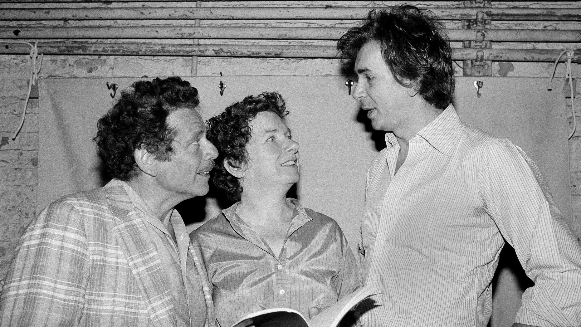 In this Aug. 18, 1980, file photo, actor Frank Langella, right, talks with Jerry Stiller, left, and Angela Paton at the Morosco Theater in New York.