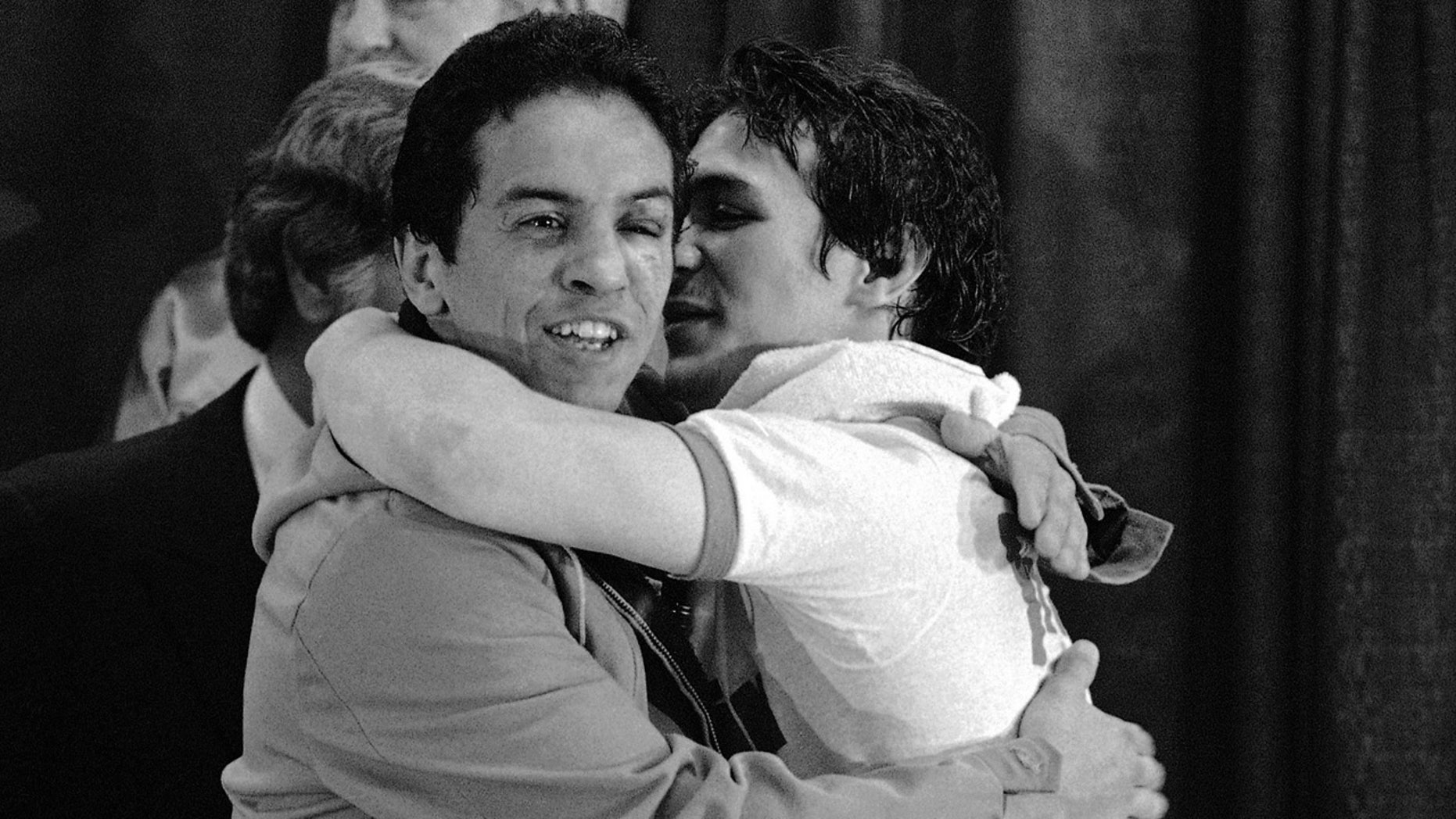In this Nov. 14, 1984 file photo, WBA lightweight champ Ray Mancini, right, gives challenger Bobby Chacon a hug after defeating him in a title fight at Reno, Nev. Chacon, a Hall of Fame boxer, died Wednesday, Sept. 7, 2016, under hospice care for dementia in Lake Elsinore, Calif. He was 64.