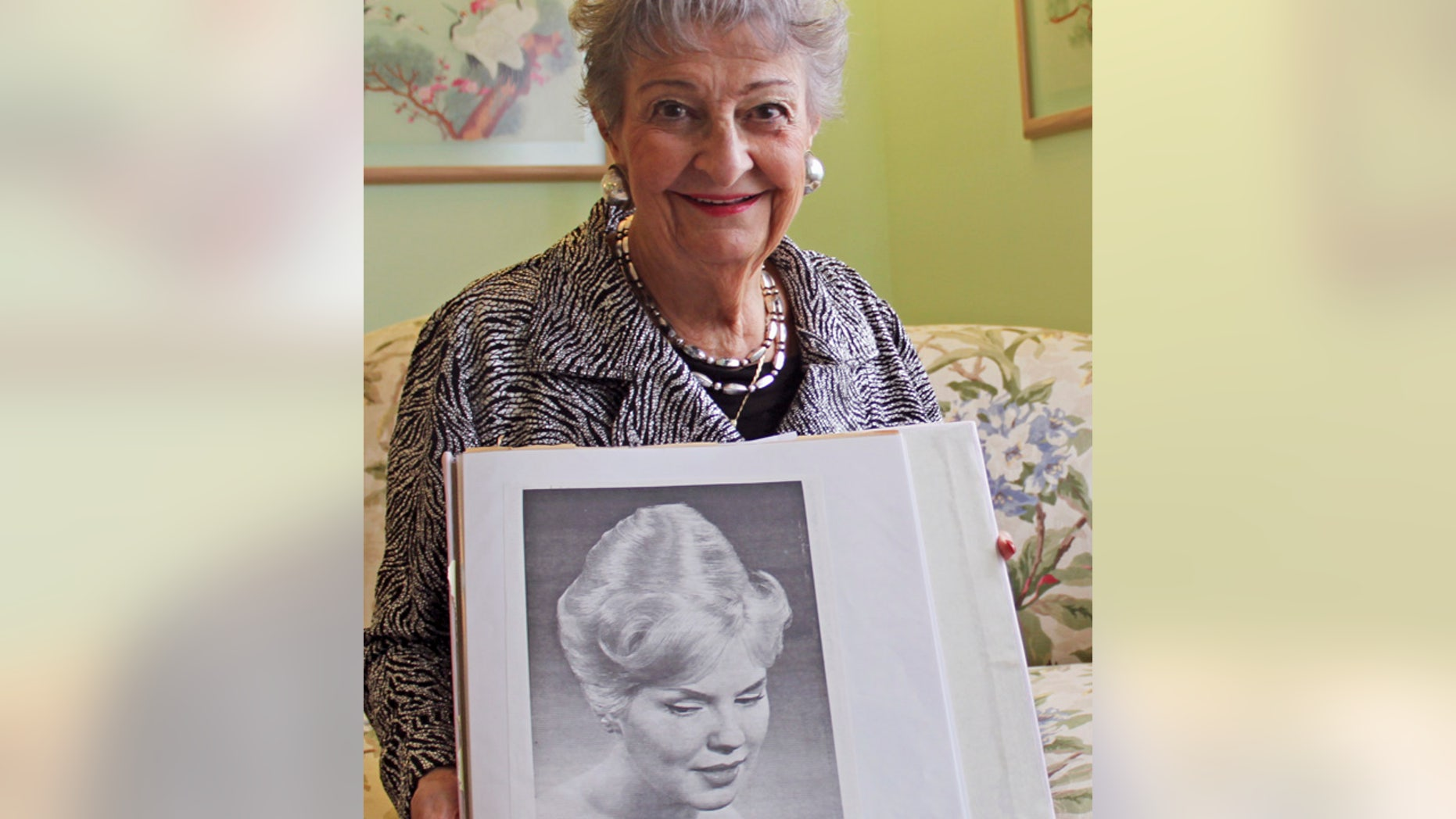 "FILE - Jan. 19, 2011:Retired hairstylist Margaret Vinci Heldt with a photo of a model with a ""beehive"" hairdo from the February 1960 edition of Modern Beauty Shop magazine."