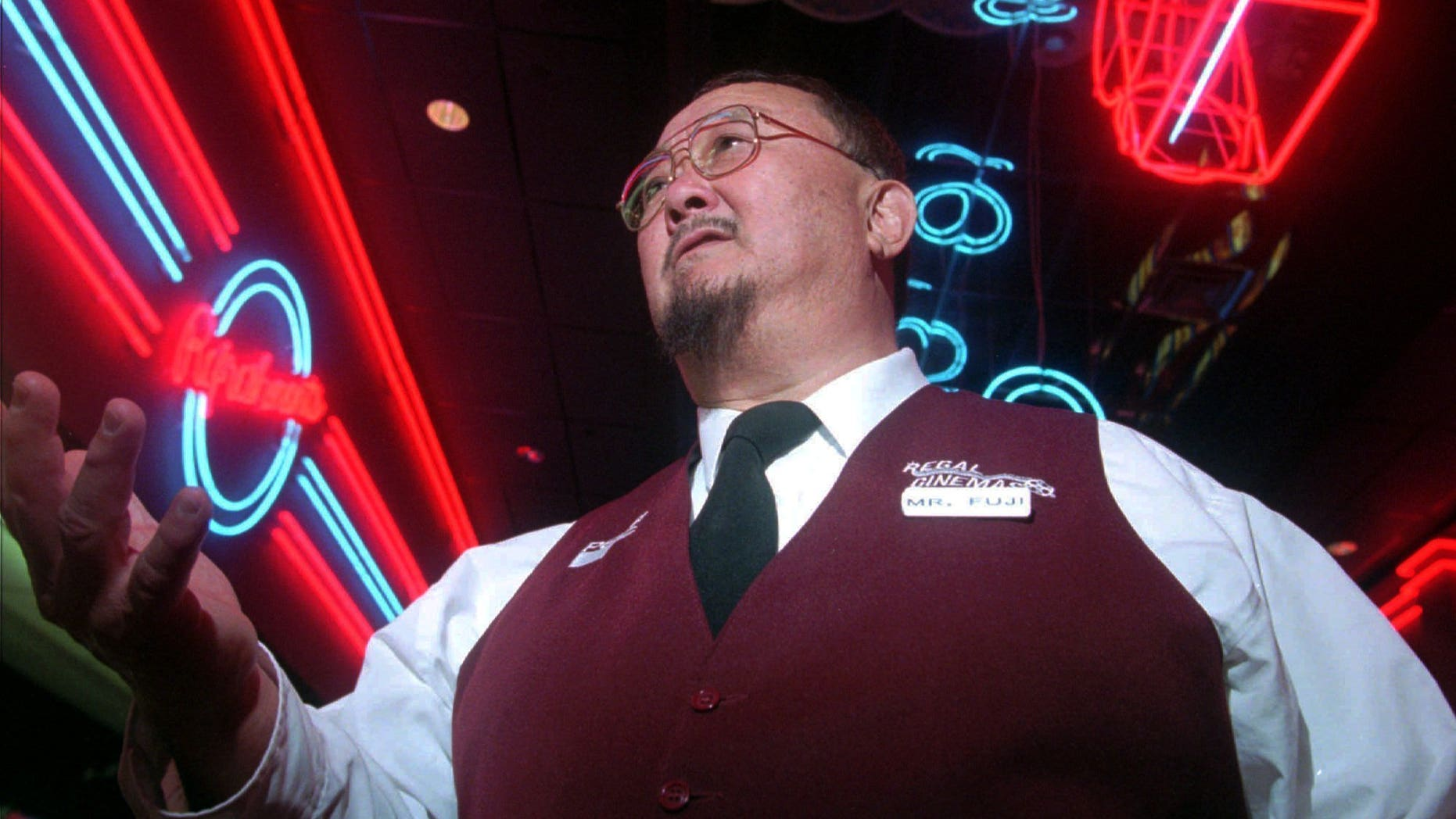 """In this April 2, 1999, file photo, Harry Fujiwara, a former wrestler known as """"Mr. Fuji,"""" appears at a movie theater where he works part time as an usher in Knoxville, Tenn."""