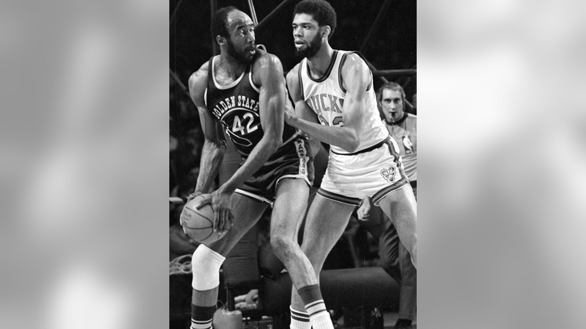 March 30, 1973: Nate Thurmond of the Golden State Warriors (42) looks back at Kareem Abdul-Jabbar of the Milwaukee Bucks before making his move toward the basket during NBA playoff action at Milwaukee, Wis.