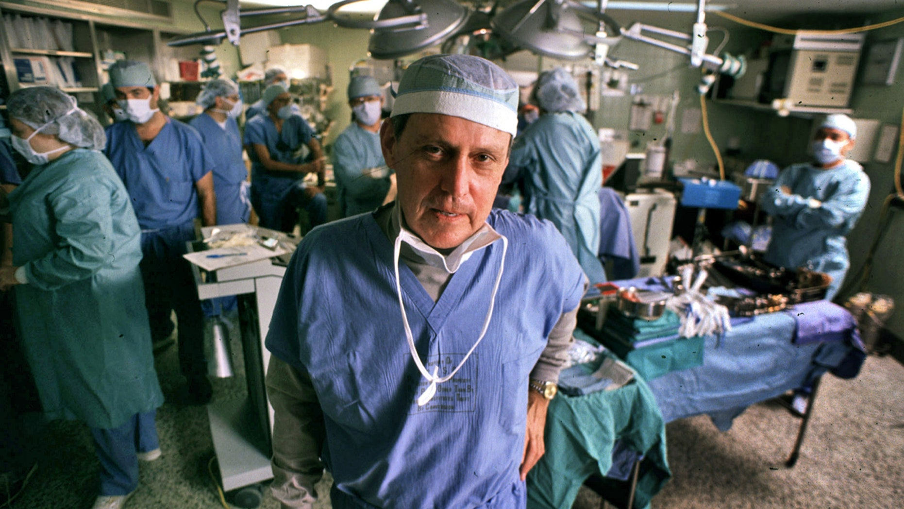 This Nov. 10, 1989 file photo shows transplant pioneer Dr. Thomas E. Starzl as he oversees a liver transplant operation at the University of Pittsburgh Medical Center in Pittsburgh.