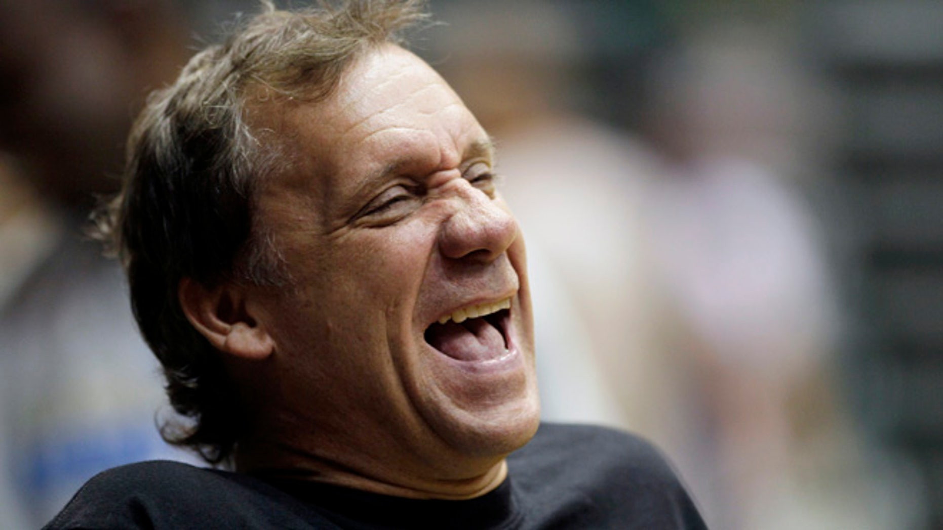 Sept. 29, 2010:  Washington Wizards coach Flip Saunders laughs during NBA basketball training camp at the Patriot Center at George Mason University in Fairfax, Va.