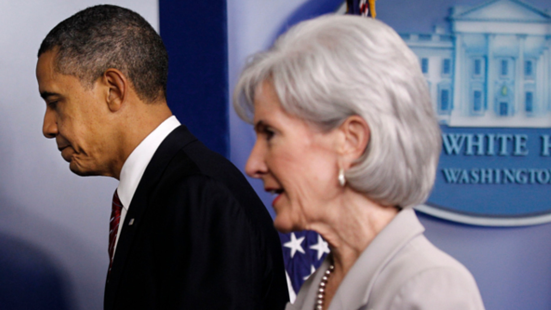 Feb. 10, 2012: President Obama and Health and Human Services Secretary Kathleen Sebelius leave the Brady Press Briefing Room of the White House in Washington.