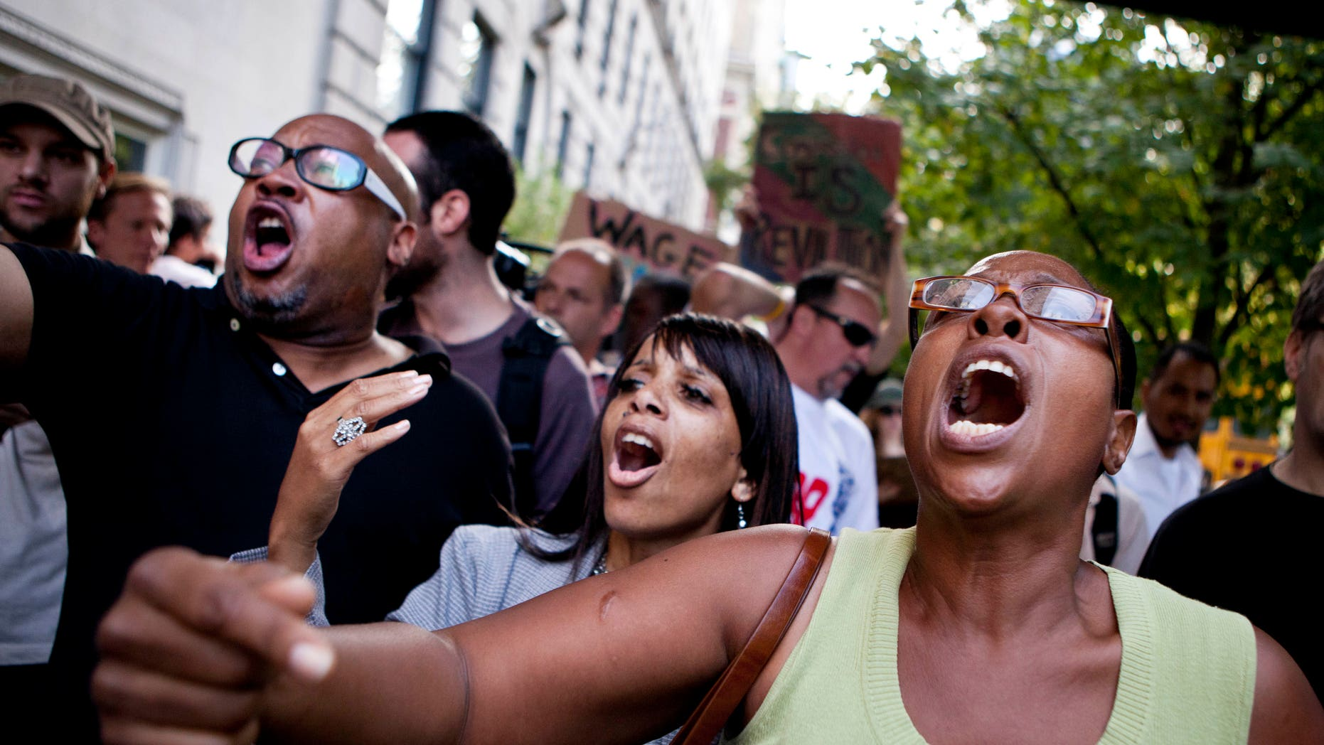 """Protestors affiliated with the """"Occupy Wall Street"""" protests chant outside 834 Fifth Avenue, where Rupert Murdoch lives, in New York, on Tuesday, Oct. 11, 2011."""
