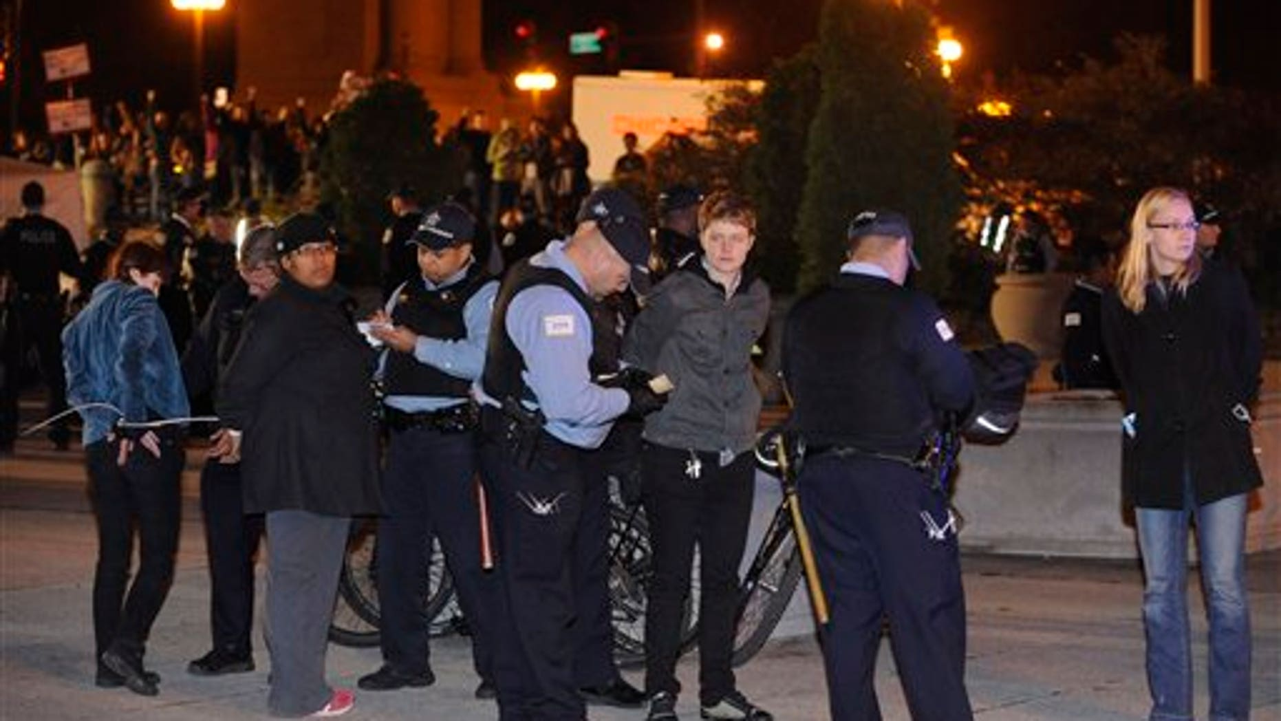 Oct. 23, 2011: Protesters are arrested during an Occupy Chicago march and protest at Grant Park in Chicago. Demonstrators of the anti-Wall Street group Occupy Chicago stood their ground in a downtown park and defied police orders to clear the area, prompting police to make more than a dozen arrests early Sunday.