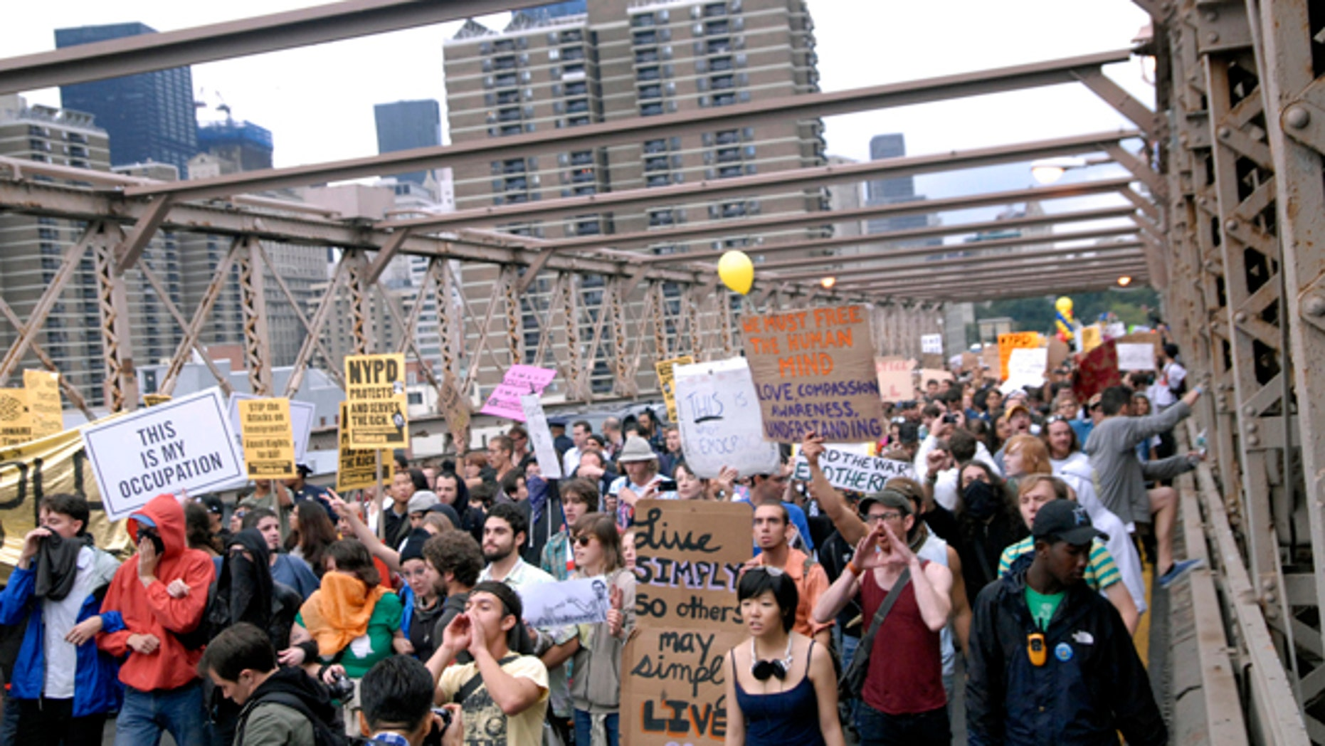 Oct. 1: Protesters walk onto New York's Brooklyn Bridge before police began making arrests during Saturday's march by Occupy Wall Street.