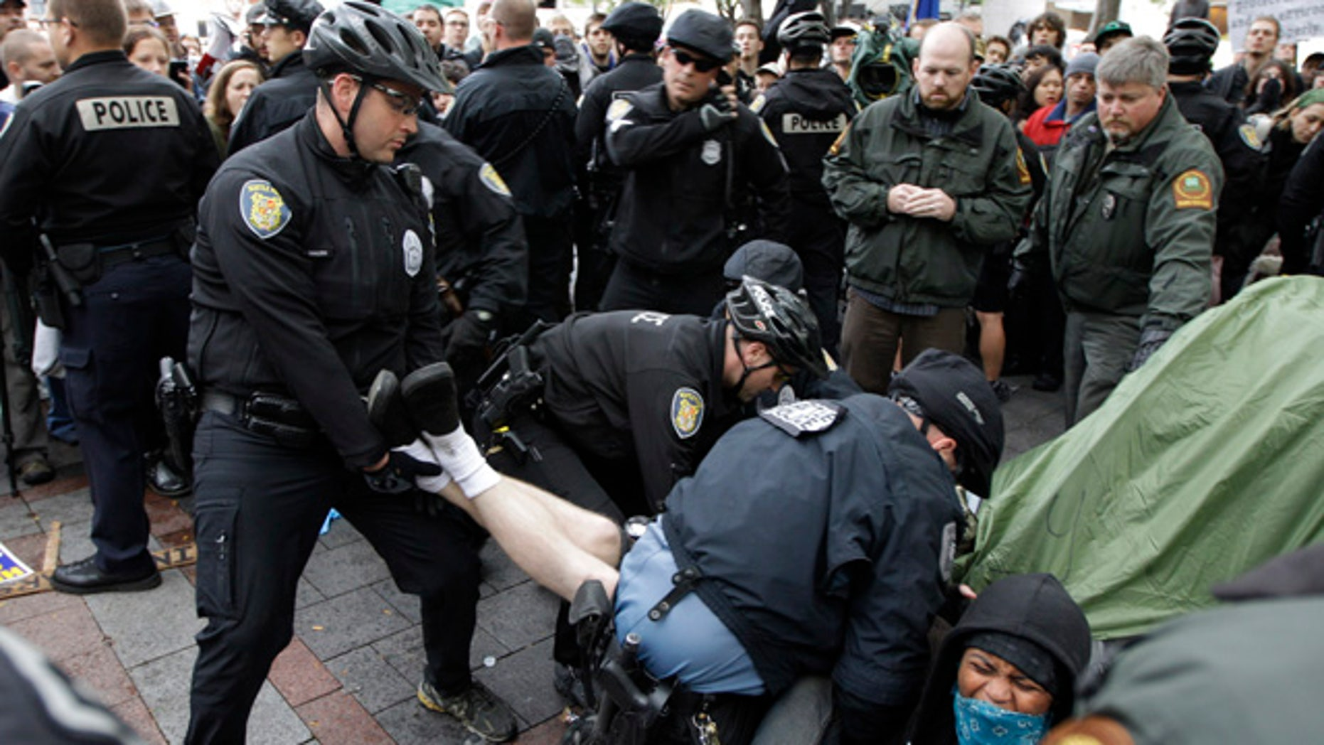 """Oct. 5: Police arrest a man who refused to leave a tent pitched at an """"Occupy Seattle"""" protest encampment in downtown Seattle's Westlake Park."""