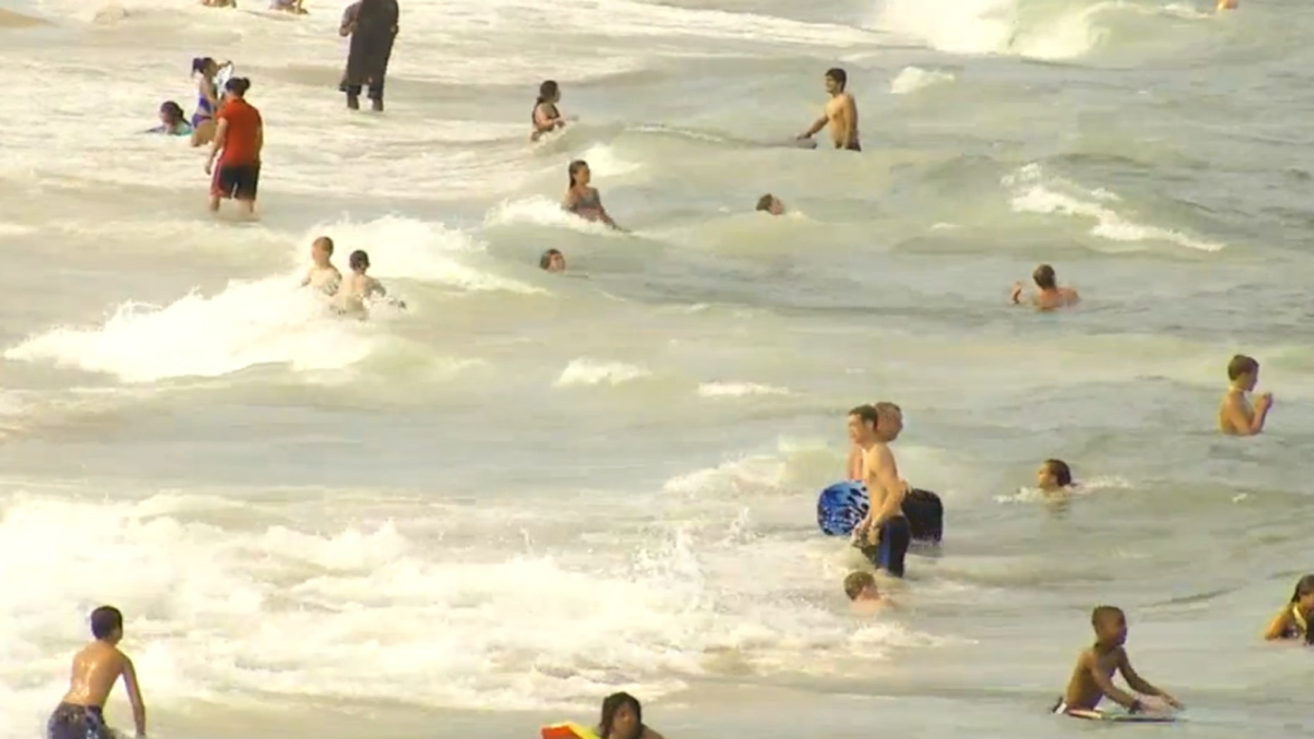 Swimmers in the ocean in Ocean City, Maryland.