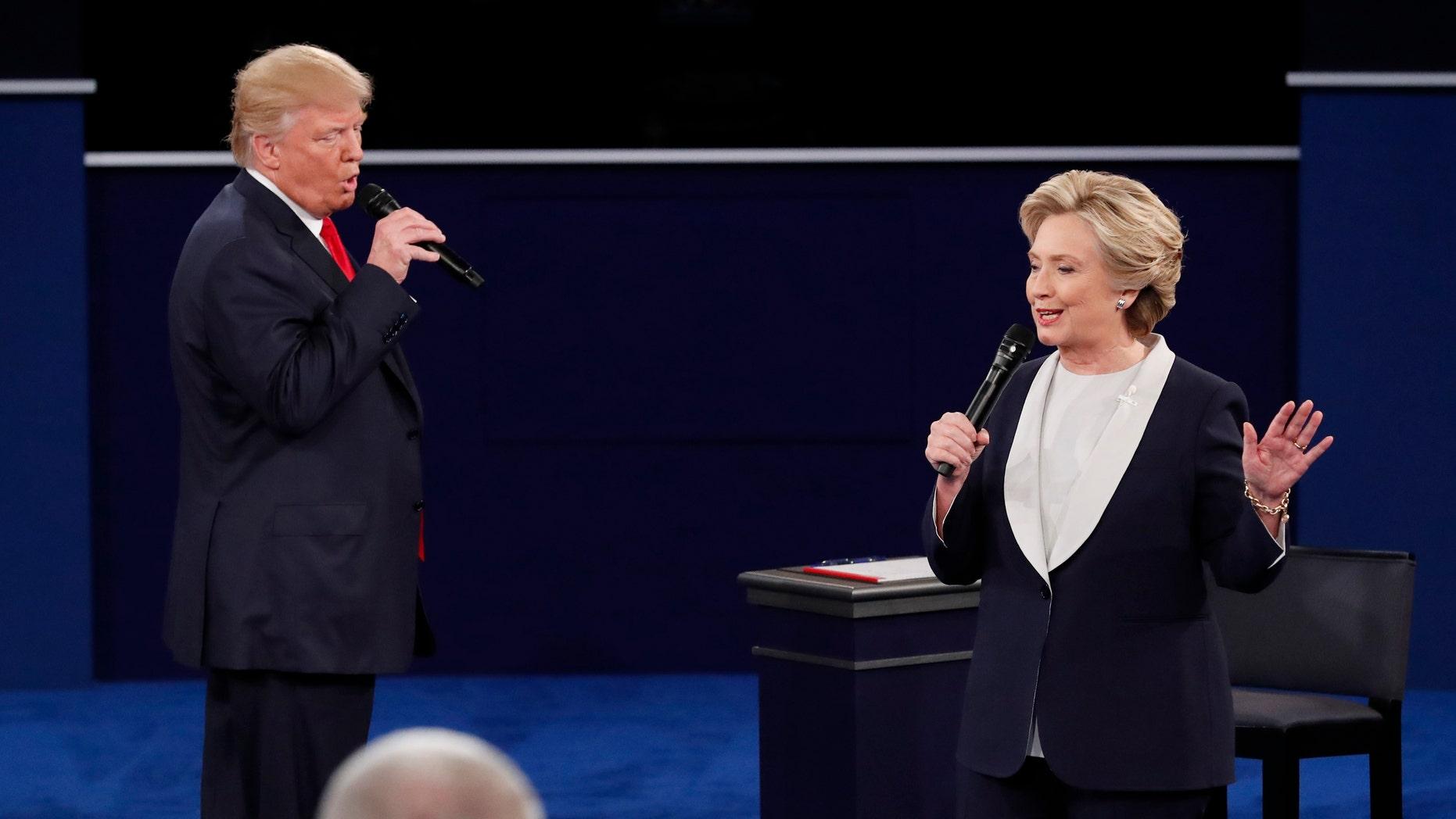 October 9, 2016: Republican presidential nominee Donald Trump and Democratic presidential nominee Hillary Clinton speak during their presidential town hall debate at Washington University in St. Louis, Missouri.