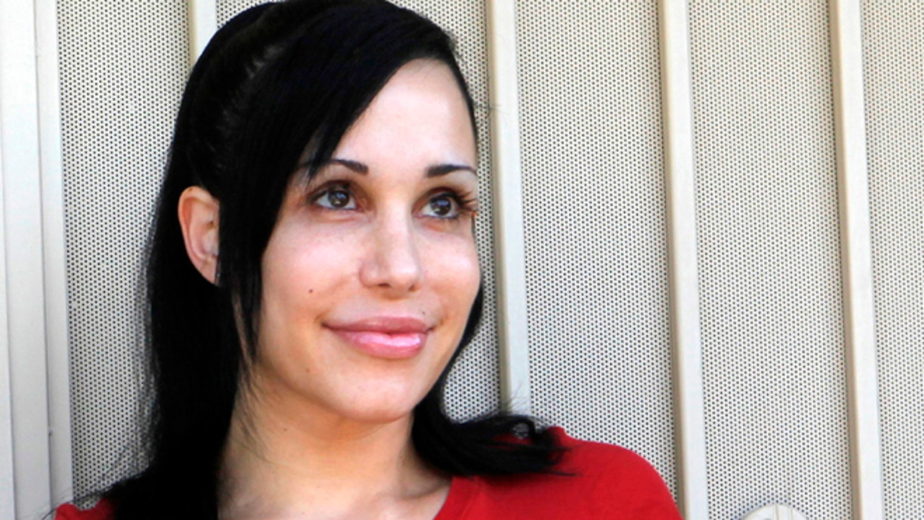 May 19, 2010: Nadya Suleman stands outside her home in La Habra, Calif.
