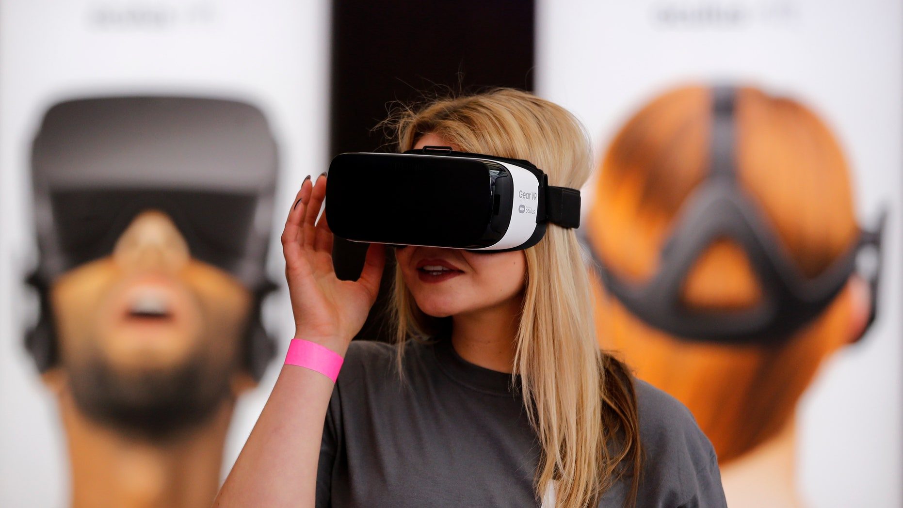 A Facebook staff uses a Gear VR virtual reality headset by Oculus and Samsung Electronics at the new Facebook Innovation Hub during a preview media tour in Berlin, Germany, February 24, 2016. (REUTERS/Fabrizio Bensch)