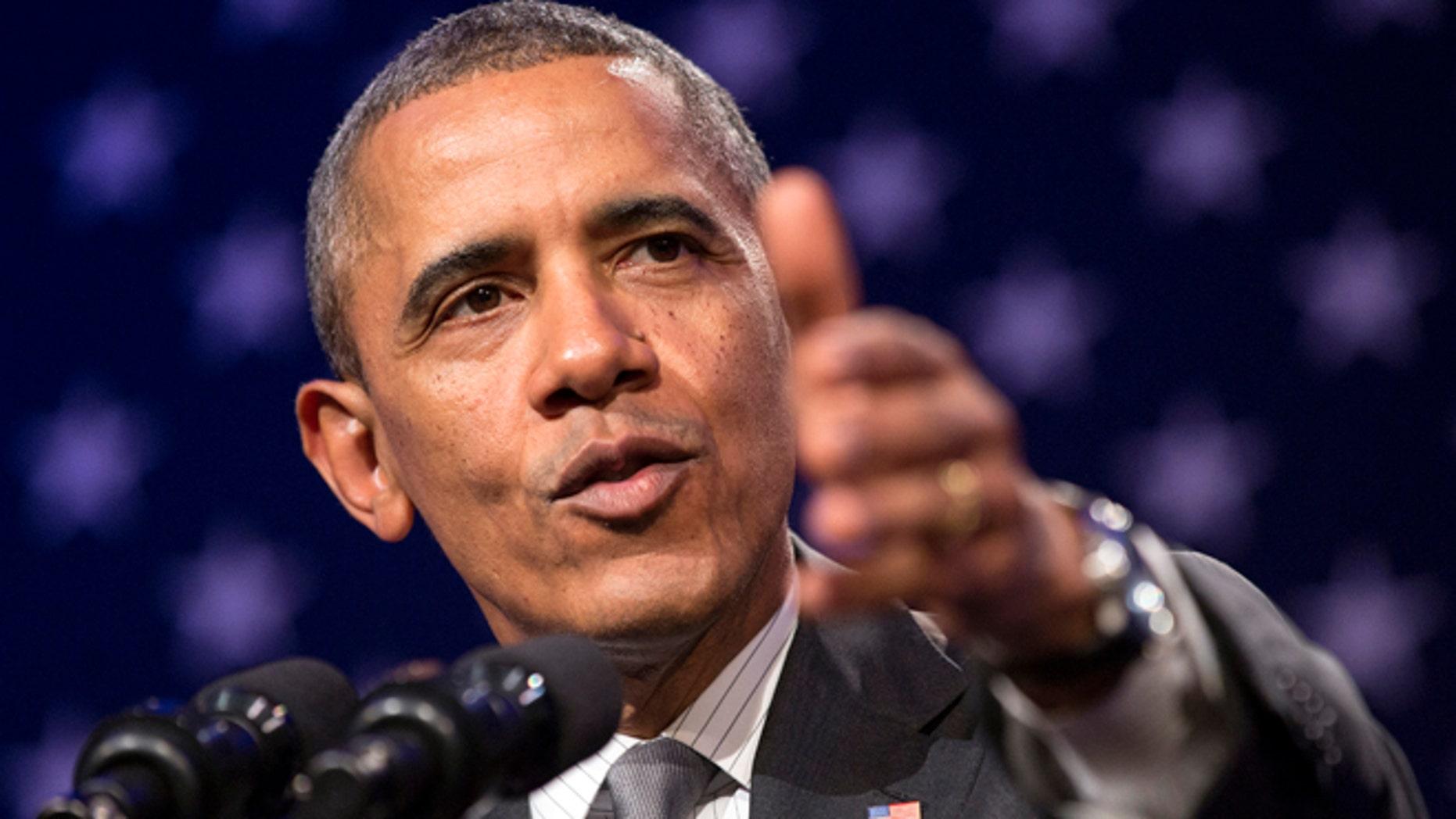 "Feb. 25, 2014: U.S. President Barack Obama delivers remarks at Organizing for Action's ""National Organizing Summit"" in Washington."