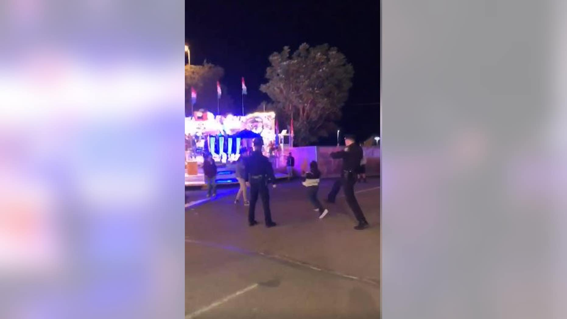 Washington police are investigating a controversial video that appears to show an officer kicking a boy in the back while breaking up a fight.