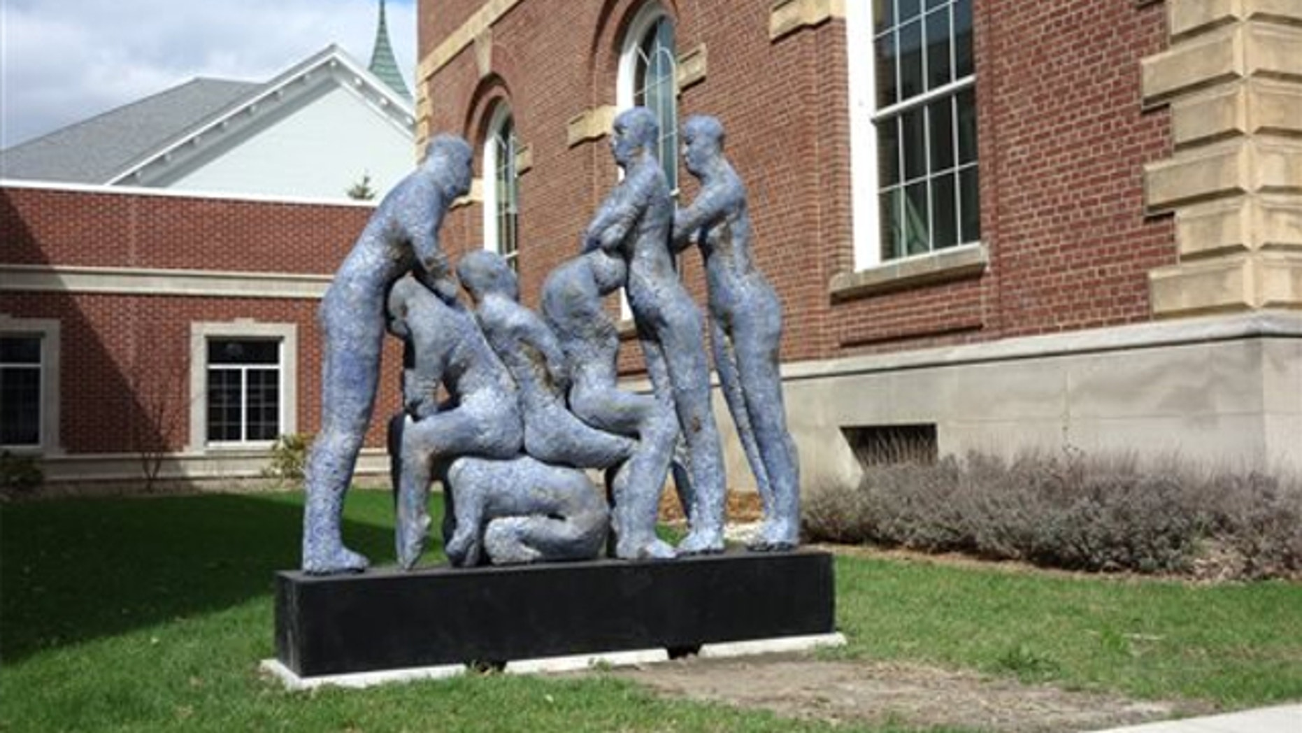 "April 22, 2014: The sculpture ""Blue Human Condition"" by Williamston, Mich., artist Mark Chatterley, is shown next to city offices in Adrian, Mich. City officials have decided to move the sculpture after complaints that it was too racy."
