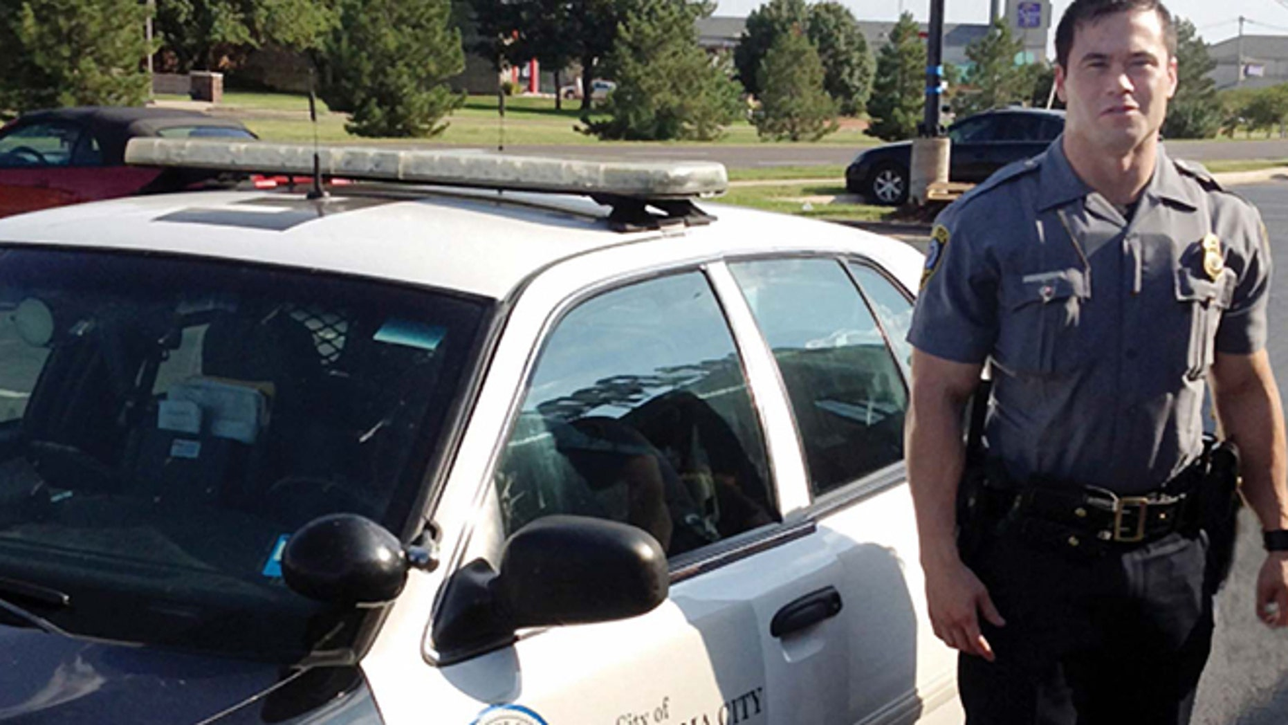 Sept. 2, 2012: In this file photo, provided by the Oklahoma Police Dept., Oklahoma City police officer Daniel Holtzclaw stands next to his vehicle.
