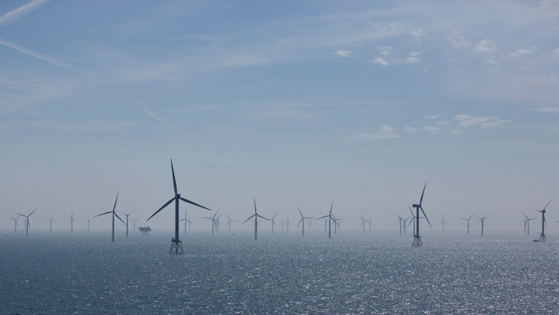 Wind turbines are pictured in RWE Offshore-Windpark Nordsee Ost in the North sea, 30 km from Helgoland, Germany, May 11, 2015.  REUTERS/Christian Charisius/Pool - LR2EB5B18VM75