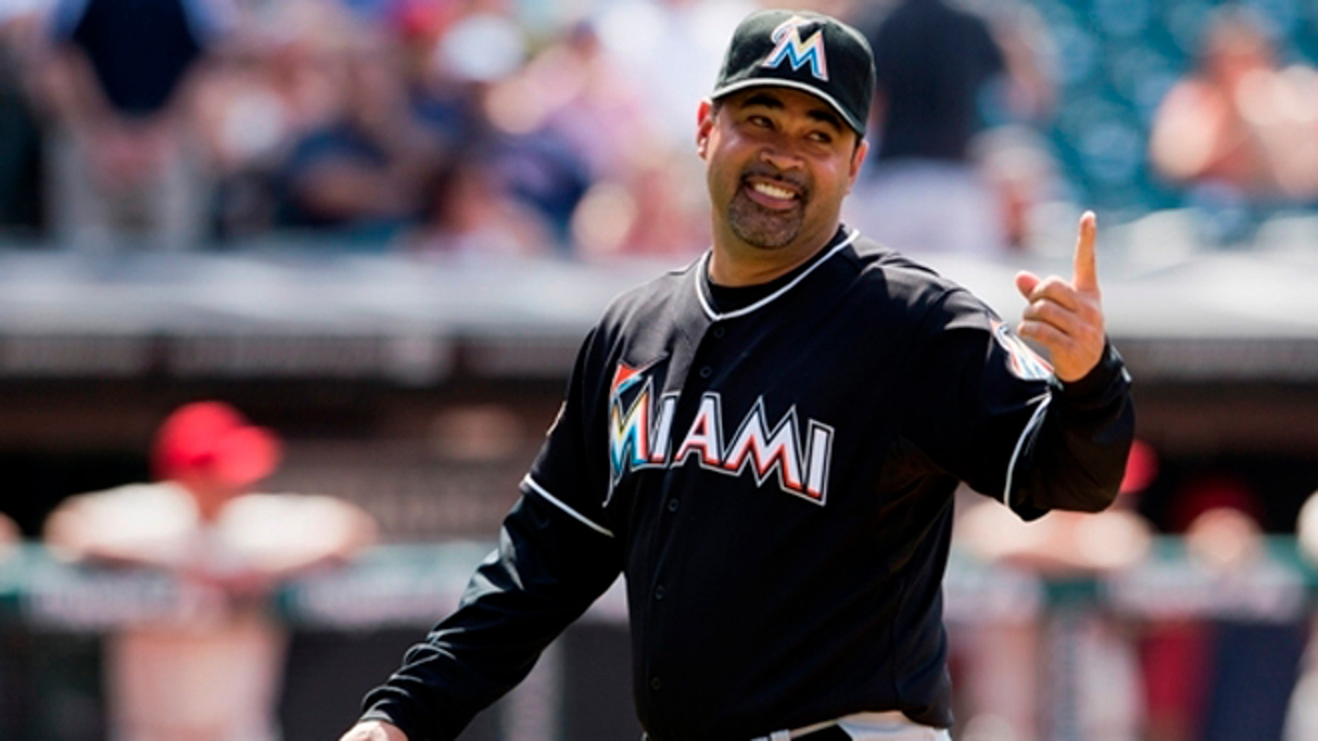 CLEVELAND, OH - MAY 20: Manager Ozzie Guillen #13 of the Miami Marlins gestures to first base after a pitching change during the eighth inning against the Cleveland Indians at Progressive Field on May 20, 2012 in Cleveland, Ohio. The Marlins defeated the Indians 5-3. (Photo by Jason Miller/Getty Images)  *** Local Caption *** Ozzie Guillen