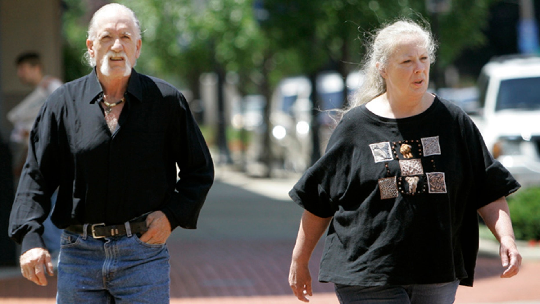 July 11, 2007: Michael and Sharen Gravelle walk through downtown Norwalk, Ohio.