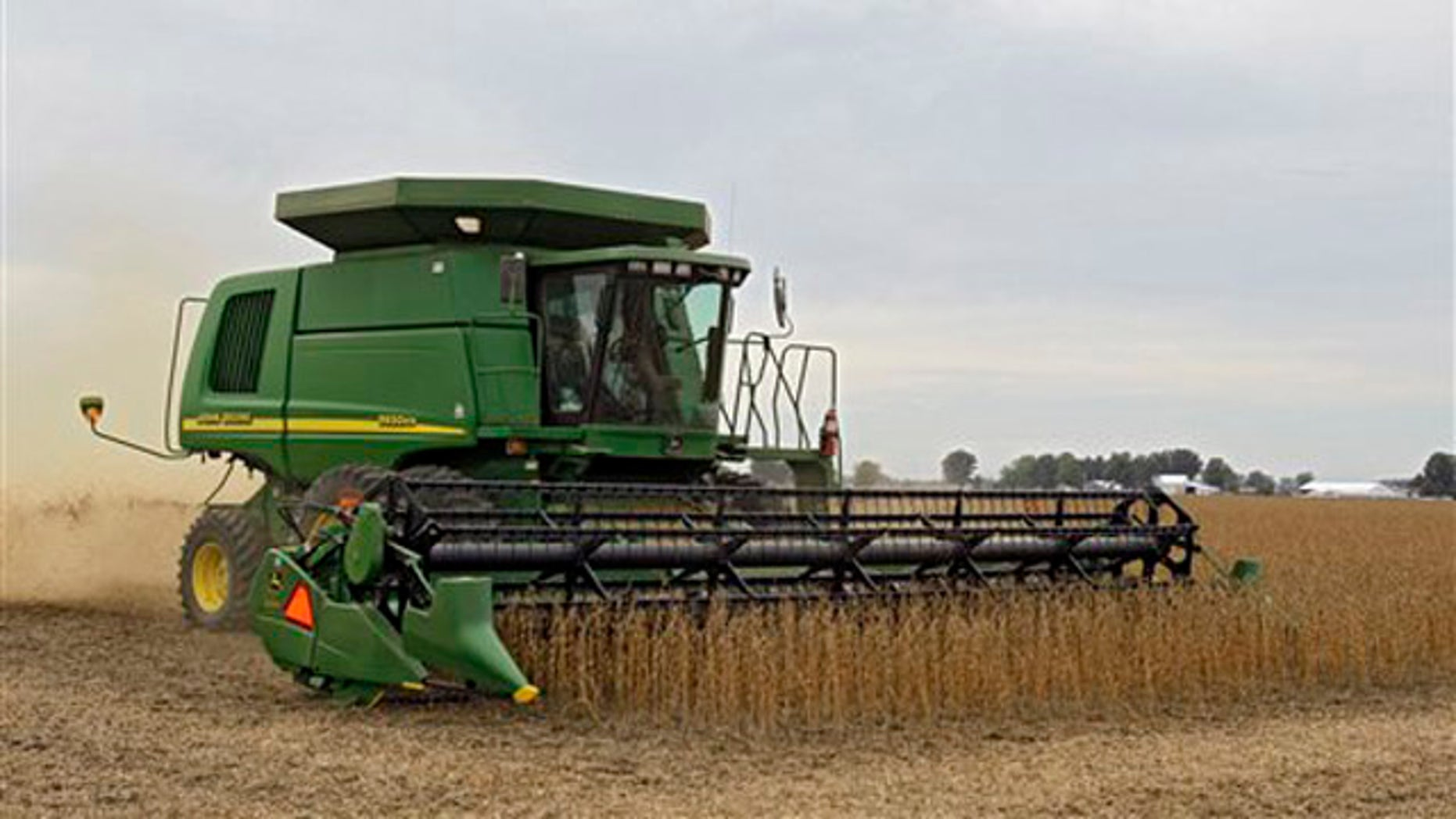 A farmer harvests soybeans in rural Erie County near Monroeville, Ohio, Oct. 10.